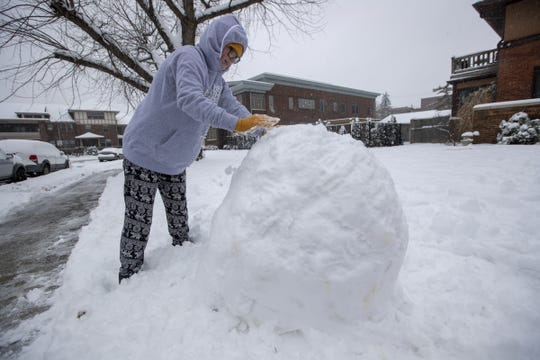 Madelin Senn, 12, works on making a snowman on Saturday, Jan. 12, 2019.