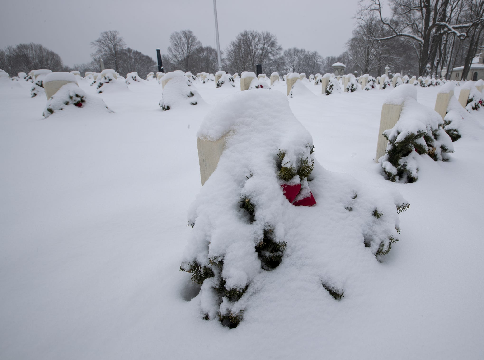 Headstones covered in snow at the Blue Star Memorial section of Crown Hill Cemetery, on a day where 5-7 inches of snow is expected to fall in Central Indiana, Indianapolis, Saturday, Jan. 12, 2019.