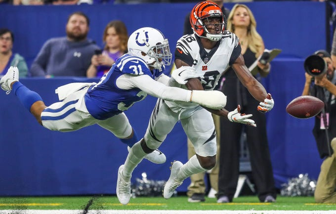 Indianapolis Colts cornerback Quincy Wilson (31) is called for pass interference against Cincinnati Bengals wide receiver A.J. Green (18) late in the first half at Lucas Oil Stadium on Sunday, Sept. 9, 2018.