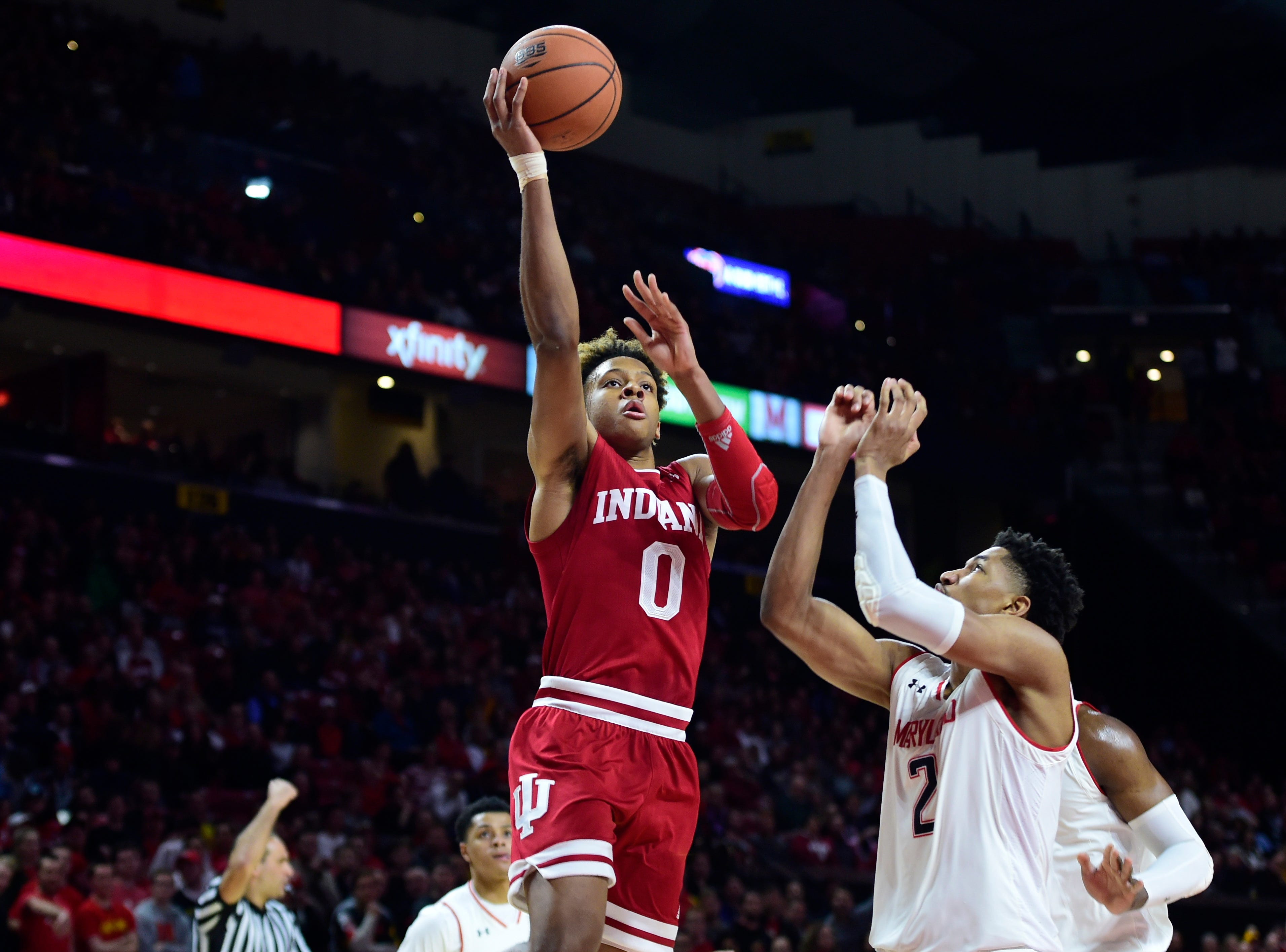 Jan 11, 2019; College Park, MD, USA;  Indiana Hoosiers guard Romeo Langford (0) shoots as Maryland Terrapins guard Aaron Wiggins (2) defends during the first half at XFINITY Center. Mandatory Credit: Tommy Gilligan-USA TODAY Sports