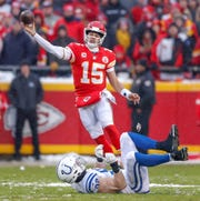 Indianapolis Colts defensive end Margus Hunt (92) can't get to Kansas City Chiefs quarterback Patrick Mahomes (15) during a pass at Arrowhead Stadium in Kansas City, Mo., on Saturday, Jan. 12, 2019.