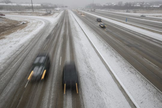 Cars on I-465 on the city's east side, on a day where 5 to 7 inches of snow is expected to fall in Central Indiana, Indianapolis, Saturday, Jan. 12, 2019.