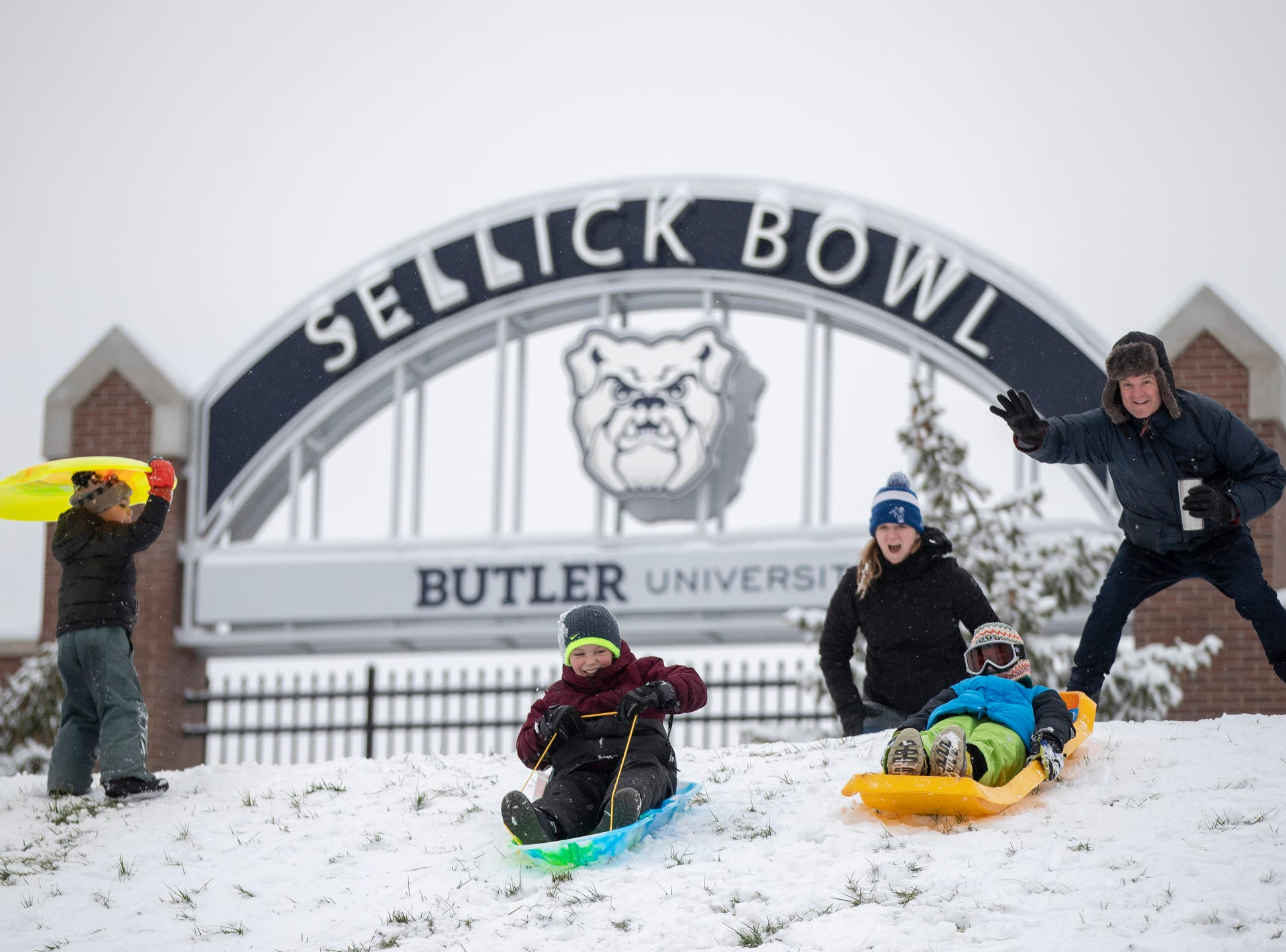 Sledders at Butler University on a day where 5-7 inches of snow is expected to fall in Central Indiana, Indianapolis, Saturday, Jan. 12, 2019.