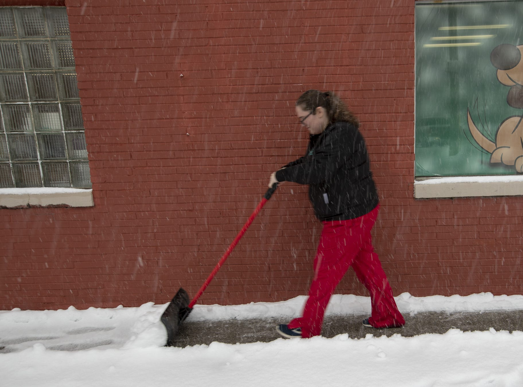 Emilea Bryum, a Veterinary Tech, shovels a walkway by Indy Paws during the morning hours, on a day that 5-7 inches of snow is expected to fall in Central Indiana, Indianapolis, Saturday, Jan. 12, 2019.
