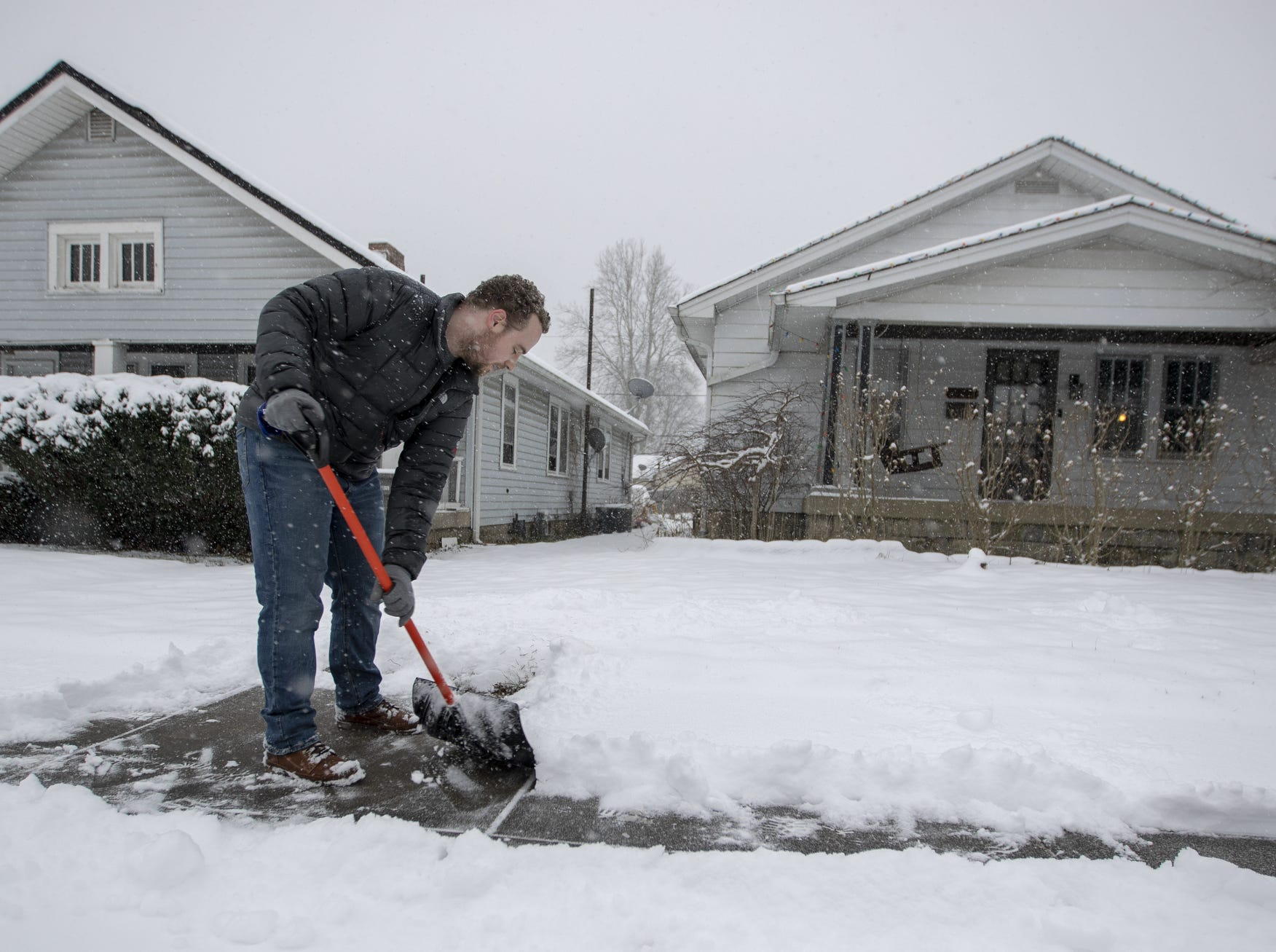 Evan Rouse shovels snow near his east side home on a day where 5-7 inches of snow is expected to fall in Central Indiana, Indianapolis, Saturday, Jan. 12, 2019.