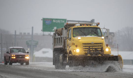 A snow plow works on 56th Street, where it crosses I-465 on the city's east side, on a day where 5 to 7 inches of snow is expected to fall in Central Indiana, Indianapolis, Saturday, Jan. 12, 2019.