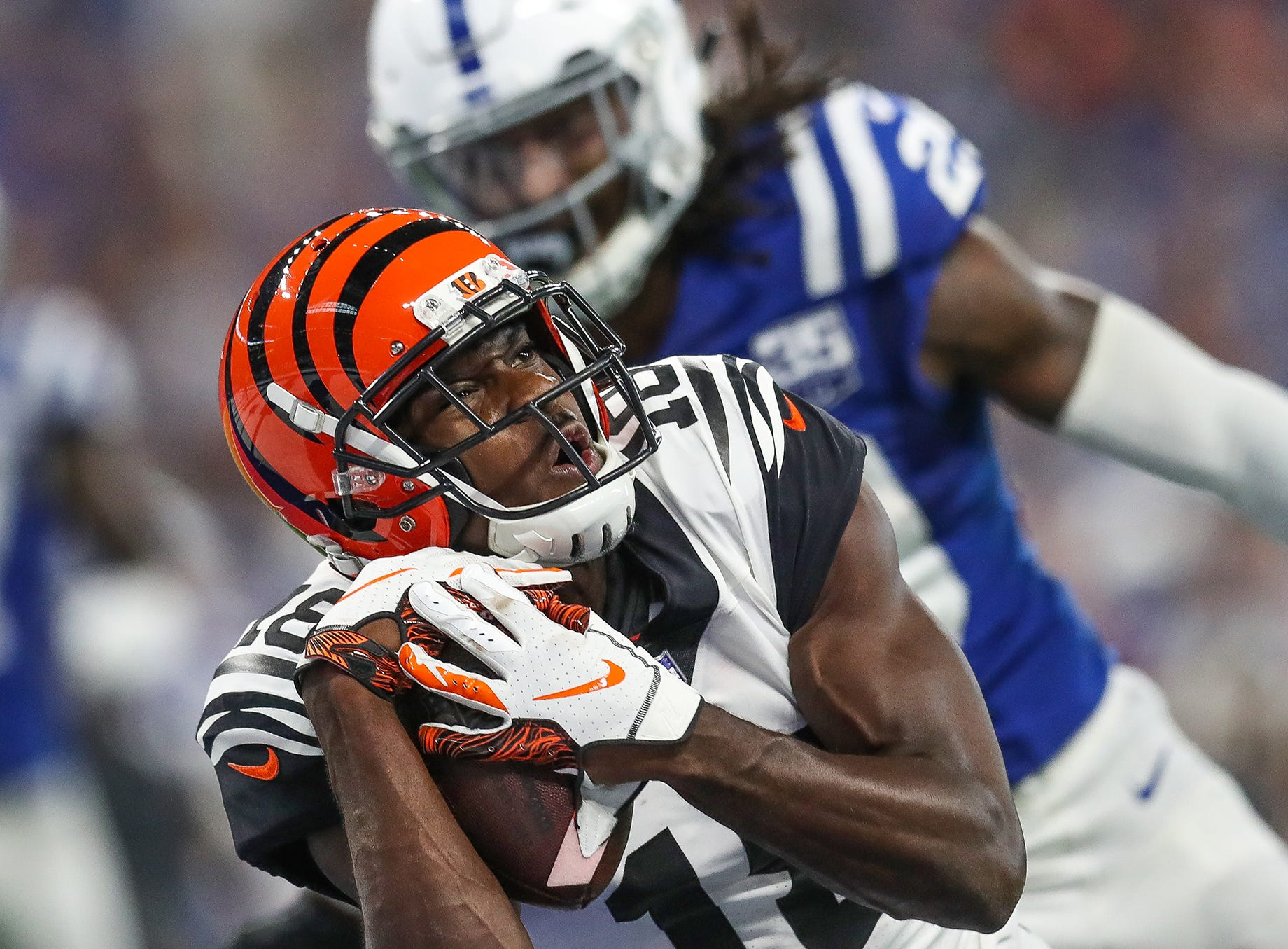 Cincinnati Bengals wide receiver A.J. Green (18) pulls in a touchdown pass from quarterback Andy Dalton (14) against the Indianapolis Colts at Lucas Oil Stadium on Sunday, Sept. 9, 2018.