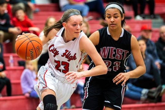 Iowa City High's Aubrey Joens (23) drives to the hoop past Waterloo West's Gabrielle Moore (23) during a Class 5A girls basketball game on Friday, Jan. 11, 2019, at City High School in Iowa City, Iowa.