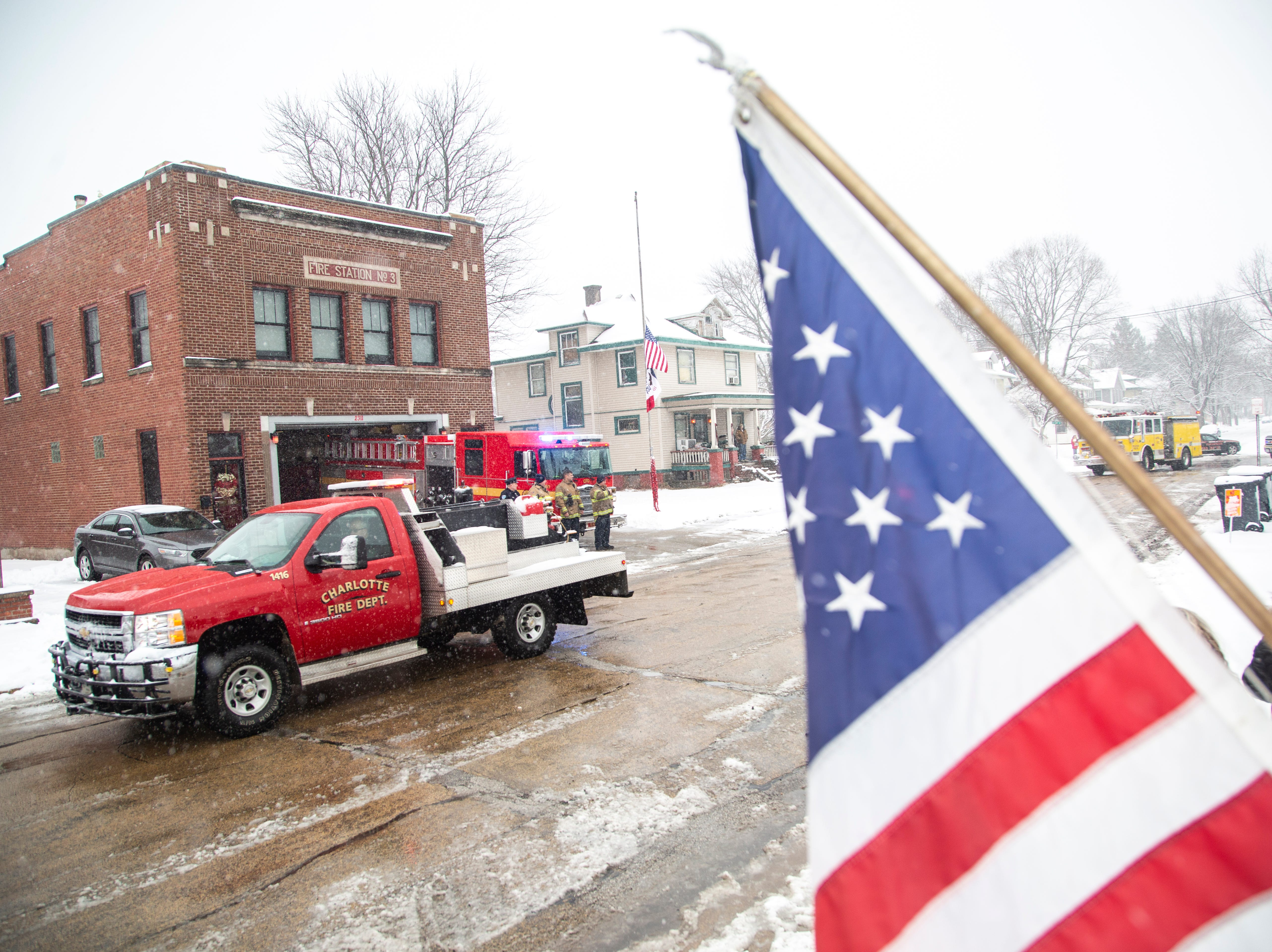 Firetrucks drive in a procession past Fire Station No. 3 as supporters look on after the public memorial service for Lt. Eric Hosette on Saturday, Jan. 12, 2019, along 2nd Street in Clinton, Iowa.