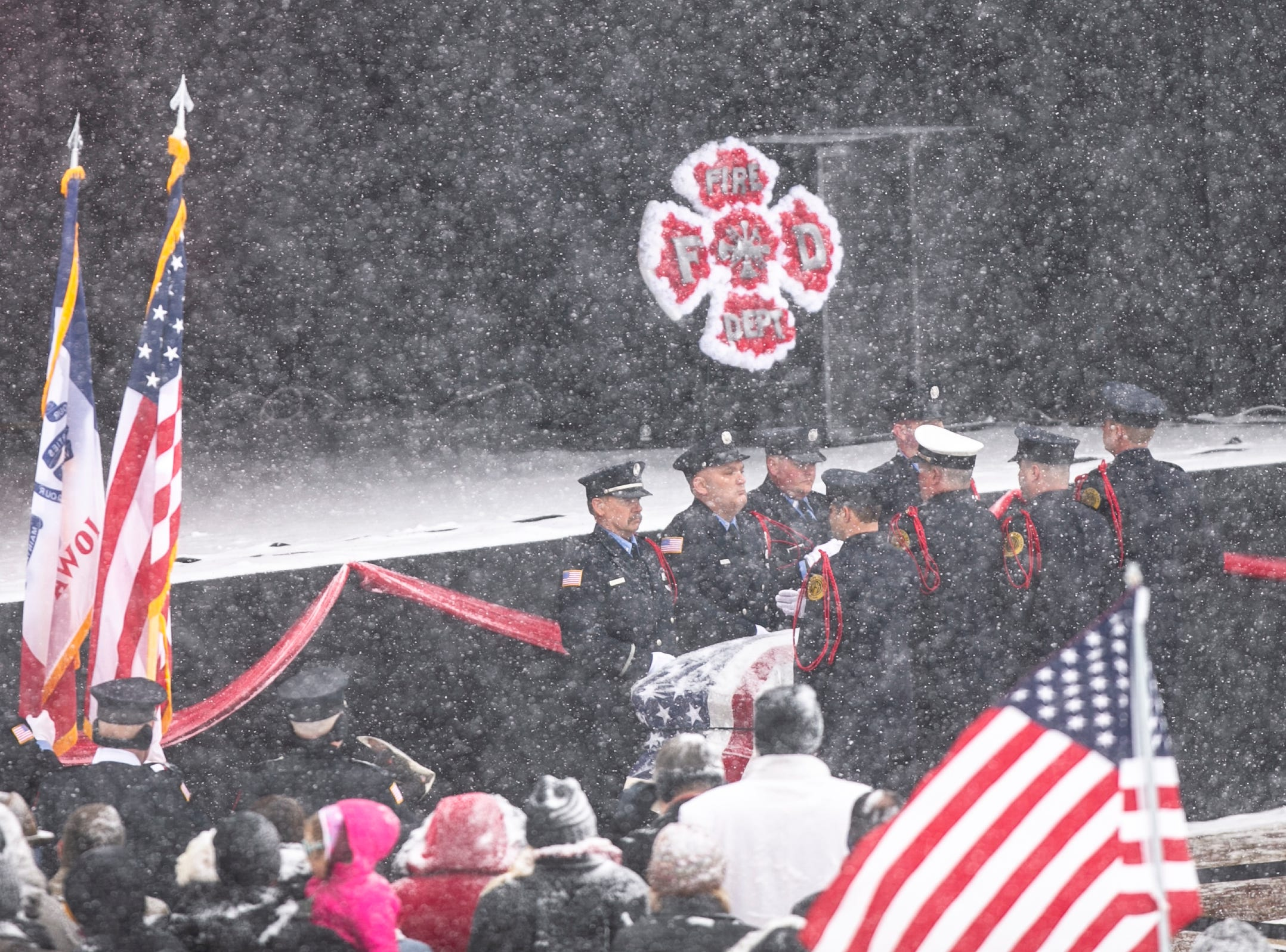 Pallbearers from the Clinton Fire Department carry the casket of Lt. Eric Hosette in during a public memorial service on Saturday, Jan. 12, 2019, at Riverview Park Bandshell in Clinton, Iowa.