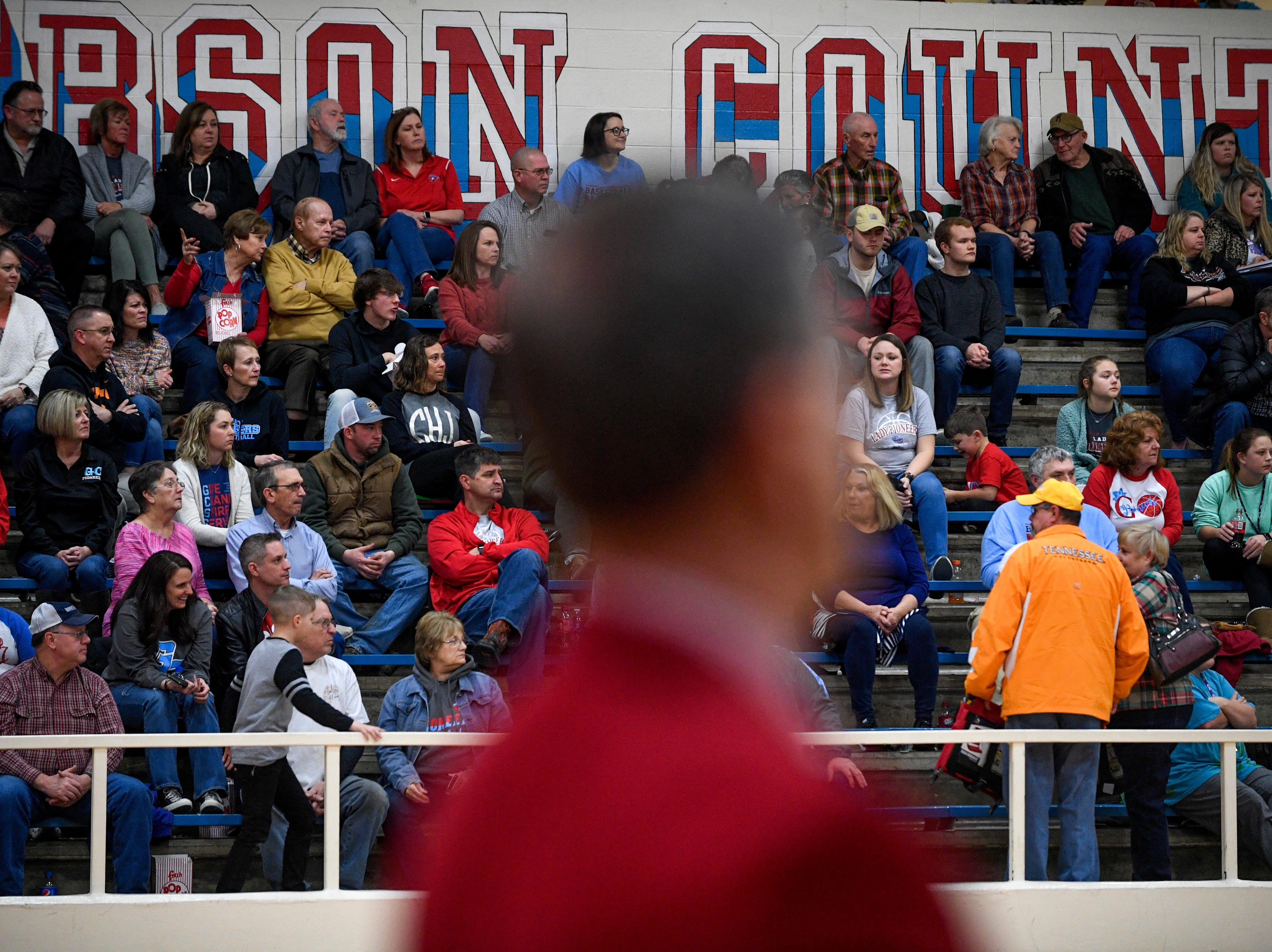 Gibson County fans sit in the stands and root on their team in a TSSAA girls basketball game between Gibson County and Trinity Christian Academy at Gibson County High School in Dyer, Tenn., on Friday, Jan. 11, 2019.