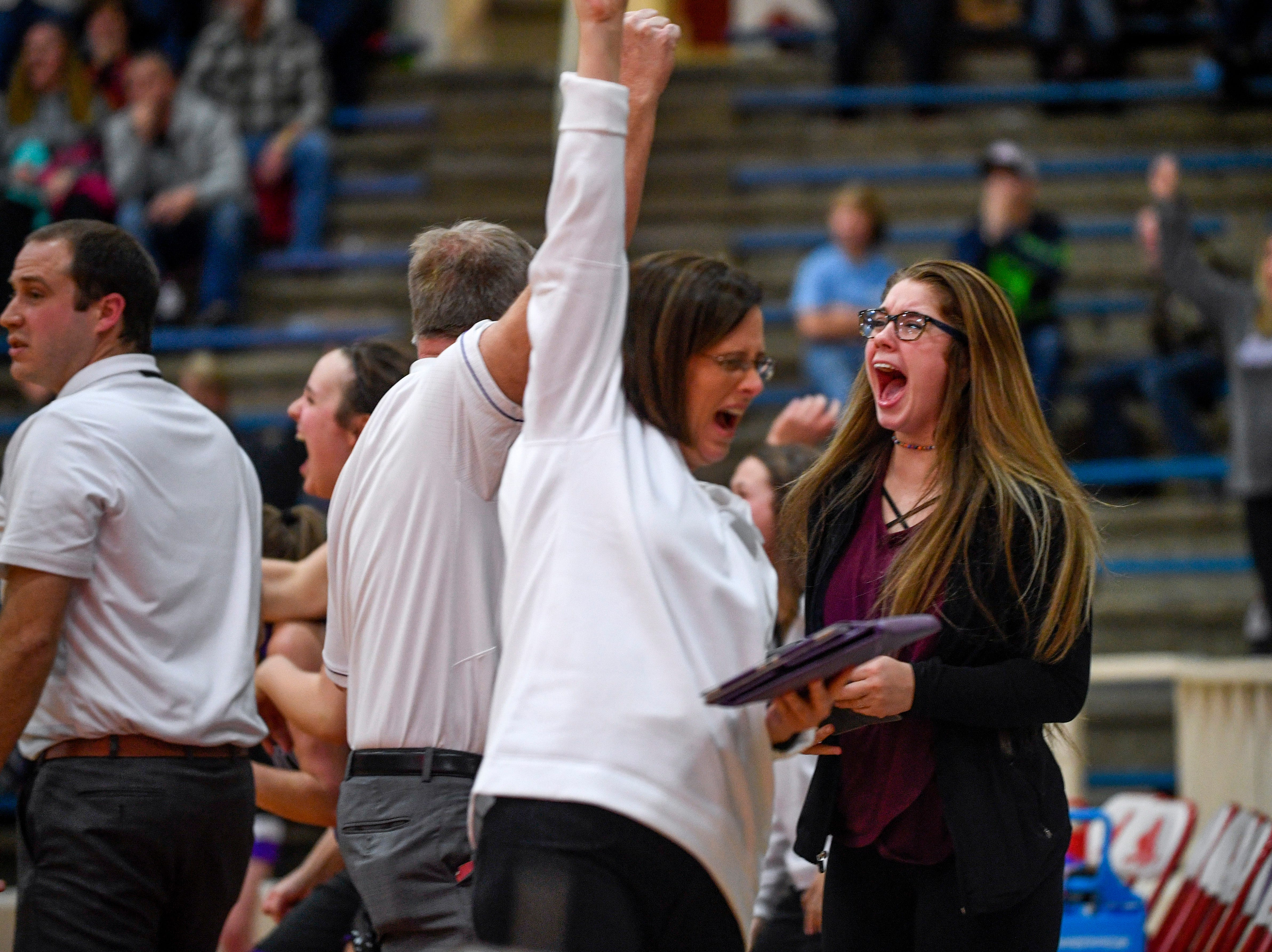 A TCA assistant coach jumps up and yells in excitement at a 3-point shot made at the buzzer to win TCA the game in a TSSAA girls basketball game between Gibson County and Trinity Christian Academy at Gibson County High School in Dyer, Tenn., on Friday, Jan. 11, 2019.