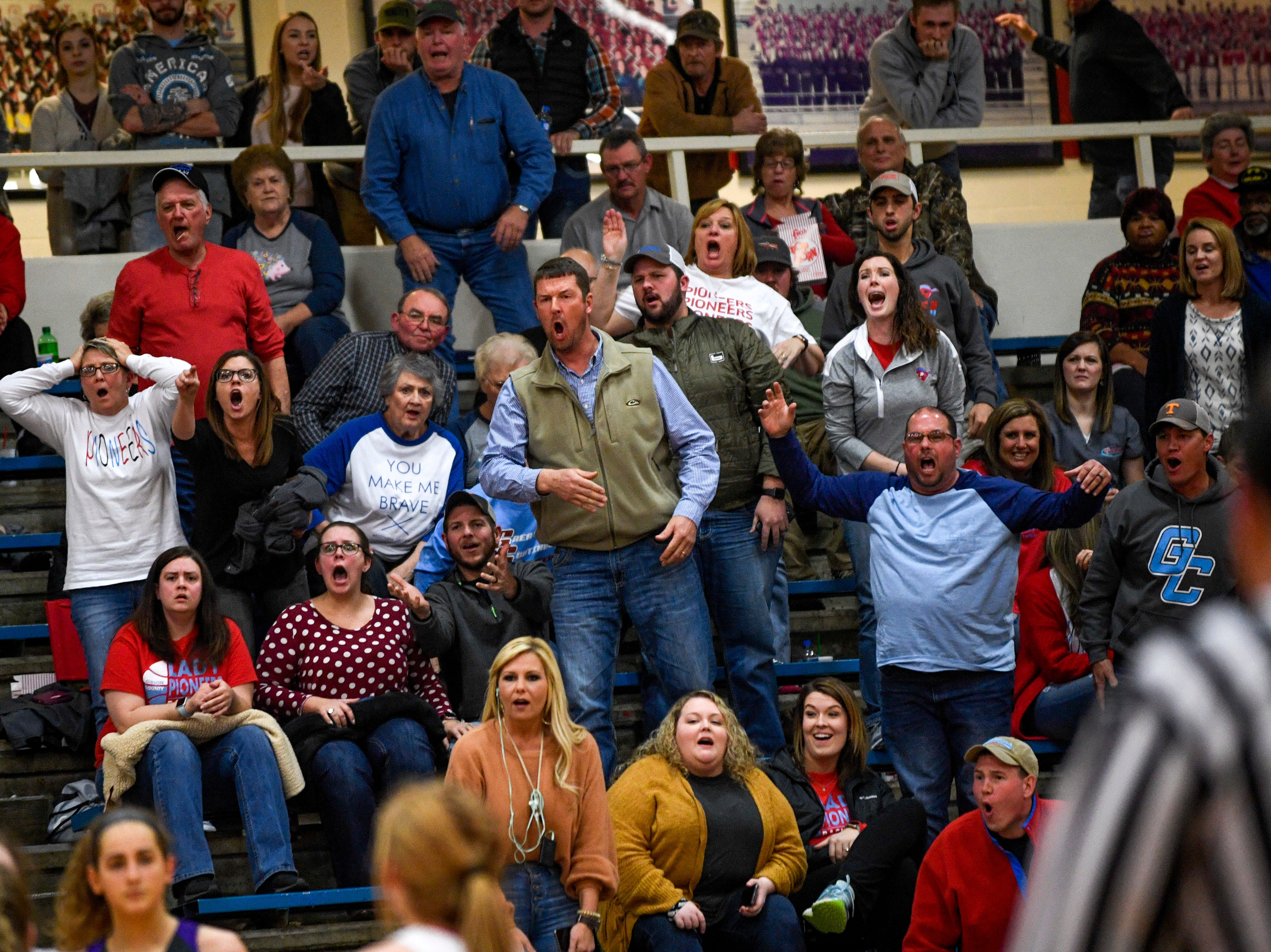 Gibson County fans yell and declare their disappointment in a referee's call in a TSSAA girls basketball game between Gibson County and Trinity Christian Academy at Gibson County High School in Dyer, Tenn., on Friday, Jan. 11, 2019.