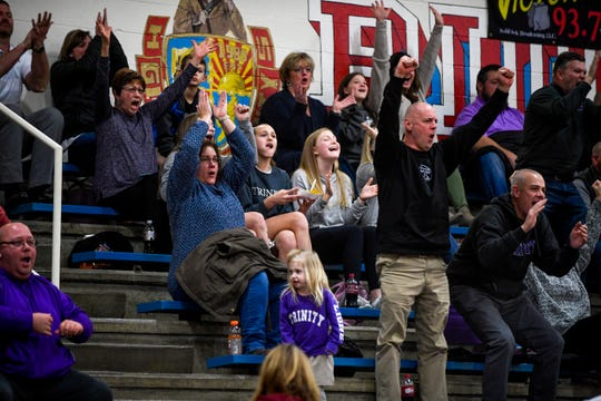TCA fans cheer from the stands in a TSSAA girls basketball game between Gibson County and Trinity Christian Academy at Gibson County High School in Dyer, Tenn., on Friday, Jan. 11, 2019.