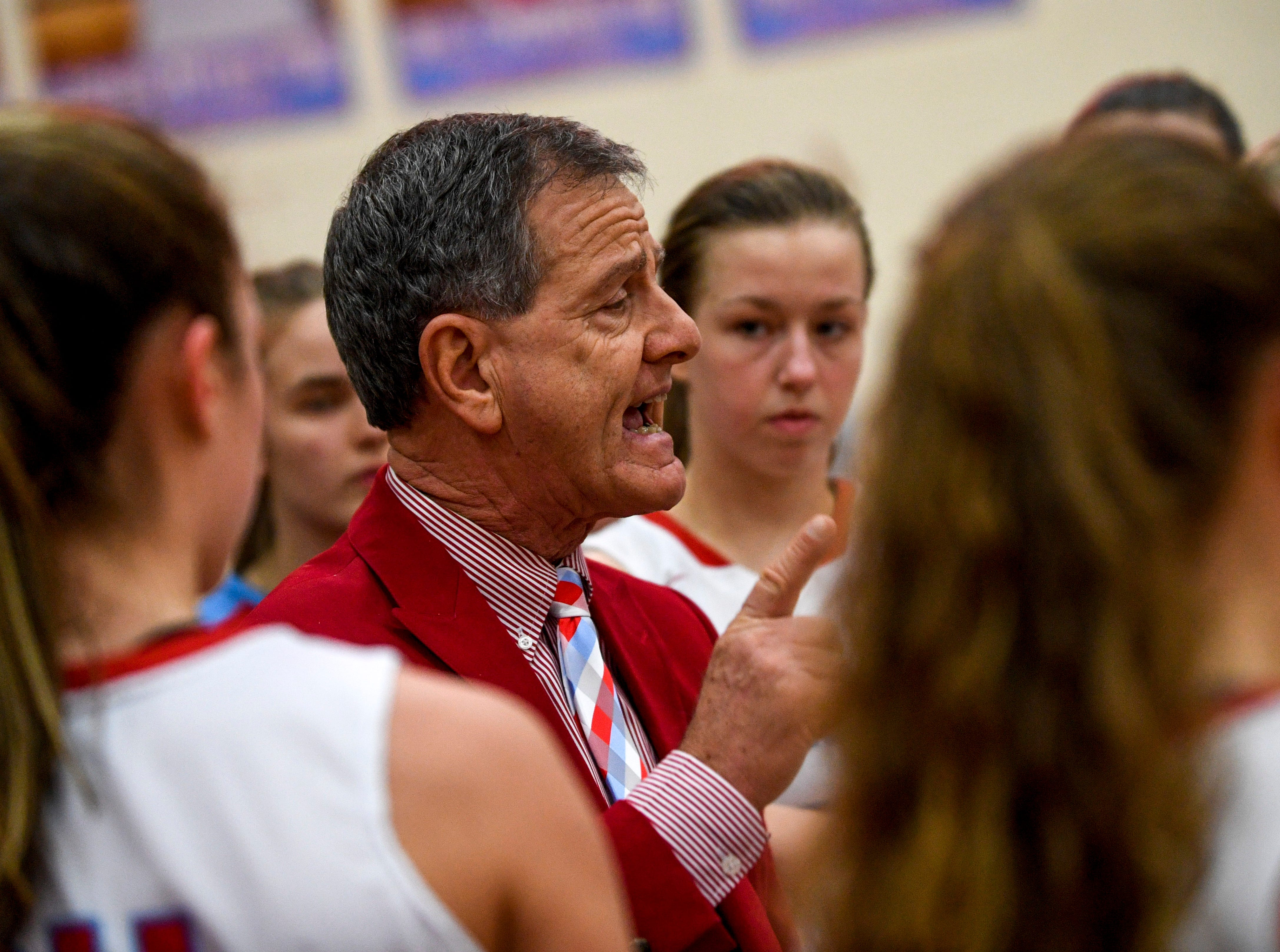 Gibson County head coach Mitch Wilkins speaks to his players in a timeout in a TSSAA girls basketball game between Gibson County and Trinity Christian Academy at Gibson County High School in Dyer, Tenn., on Friday, Jan. 11, 2019.