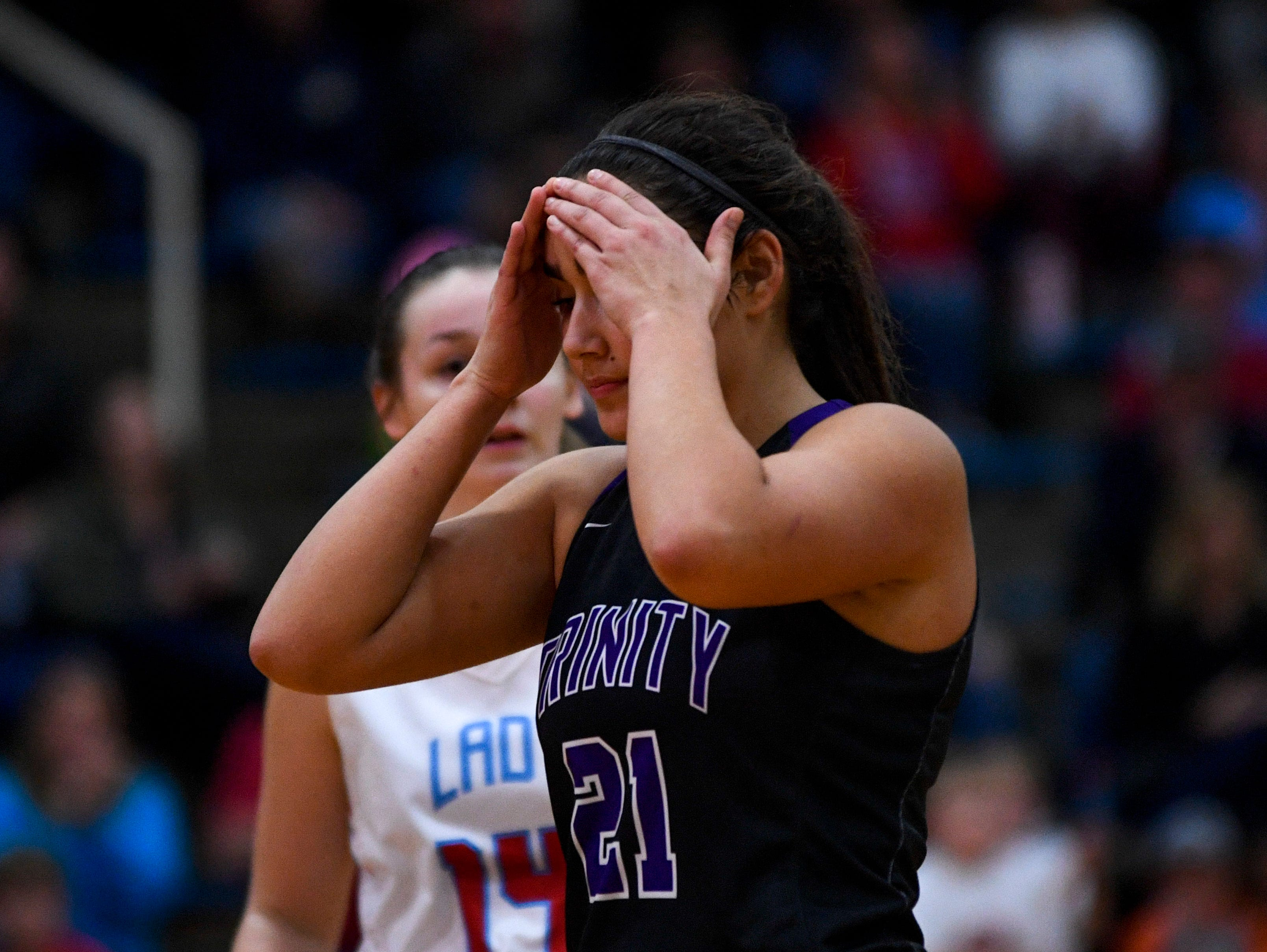 TCA's Emma Pagoaga (21) puts her hands over her forehead in distress after the ball flips possession during overtime in a TSSAA girls basketball game between Gibson County and Trinity Christian Academy at Gibson County High School in Dyer, Tenn., on Friday, Jan. 11, 2019.