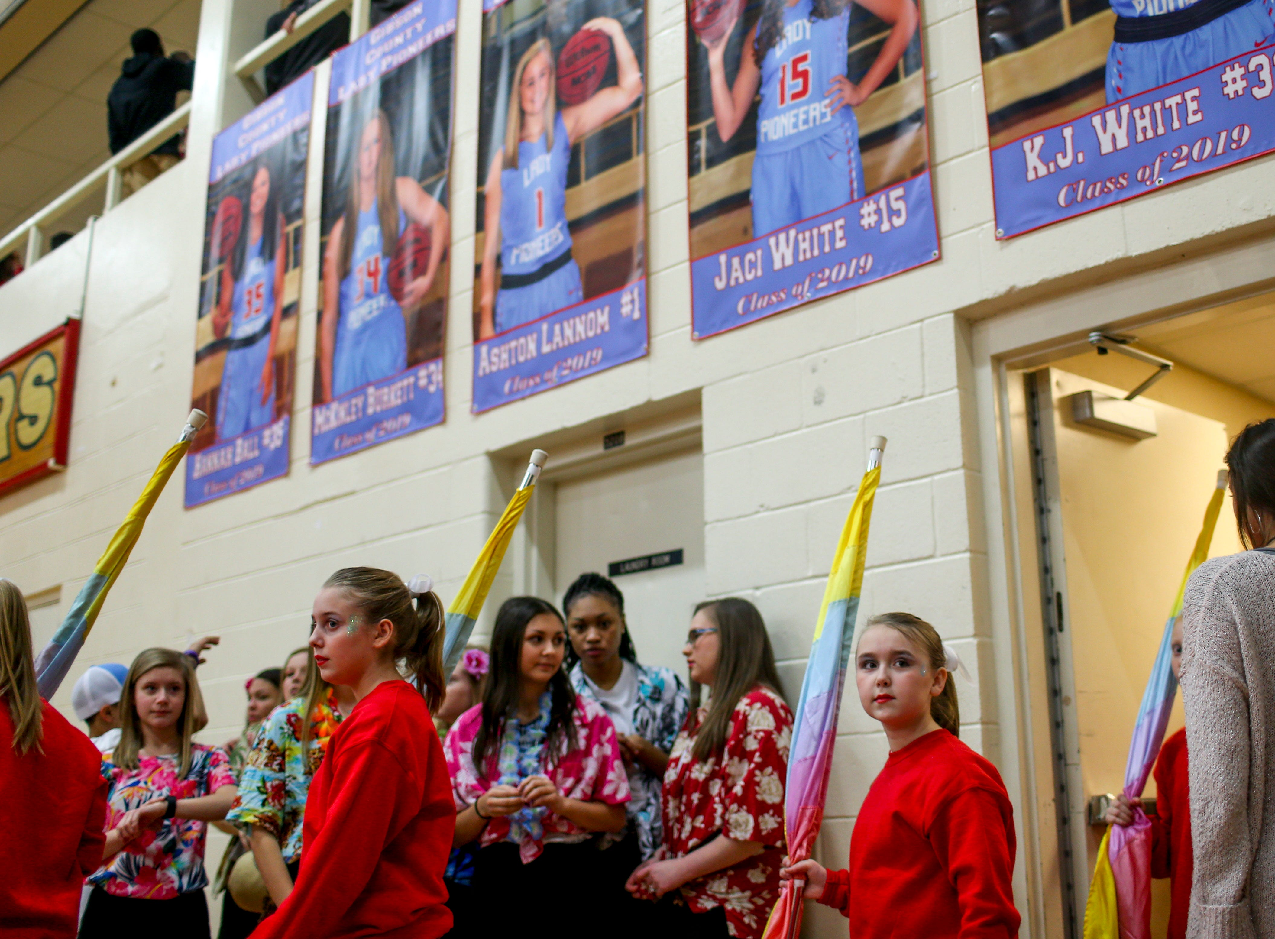 A half time performer emerges from the locker room doors and looks up at the crowd gathered at halftime in a TSSAA girls basketball game between Gibson County and Trinity Christian Academy at Gibson County High School in Dyer, Tenn., on Friday, Jan. 11, 2019.