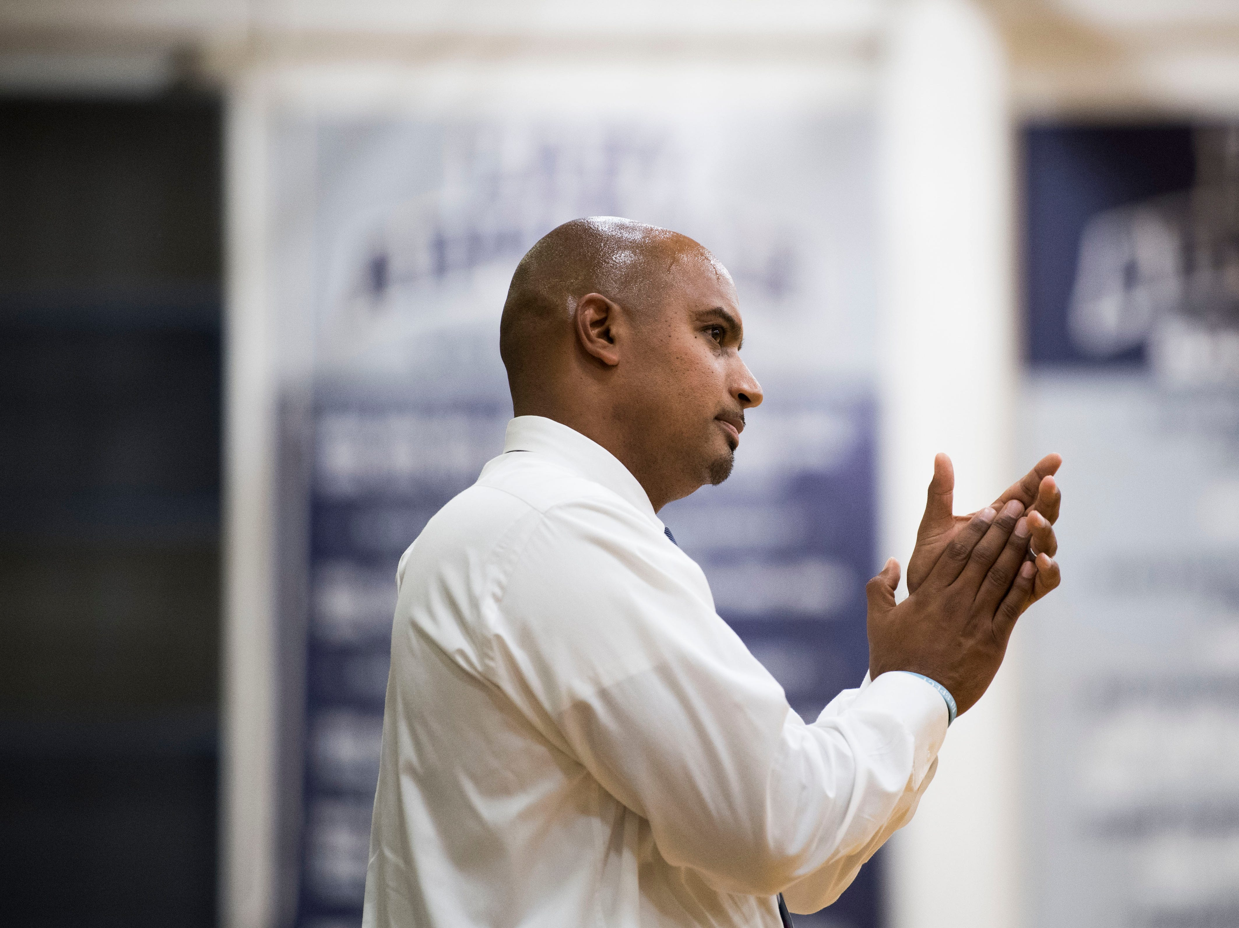 Farragut head coach Jon Higgins claps from the sidelines during a high school basketball game between Maryville and Farragut at Farragut, Friday, Jan. 11, 2019.