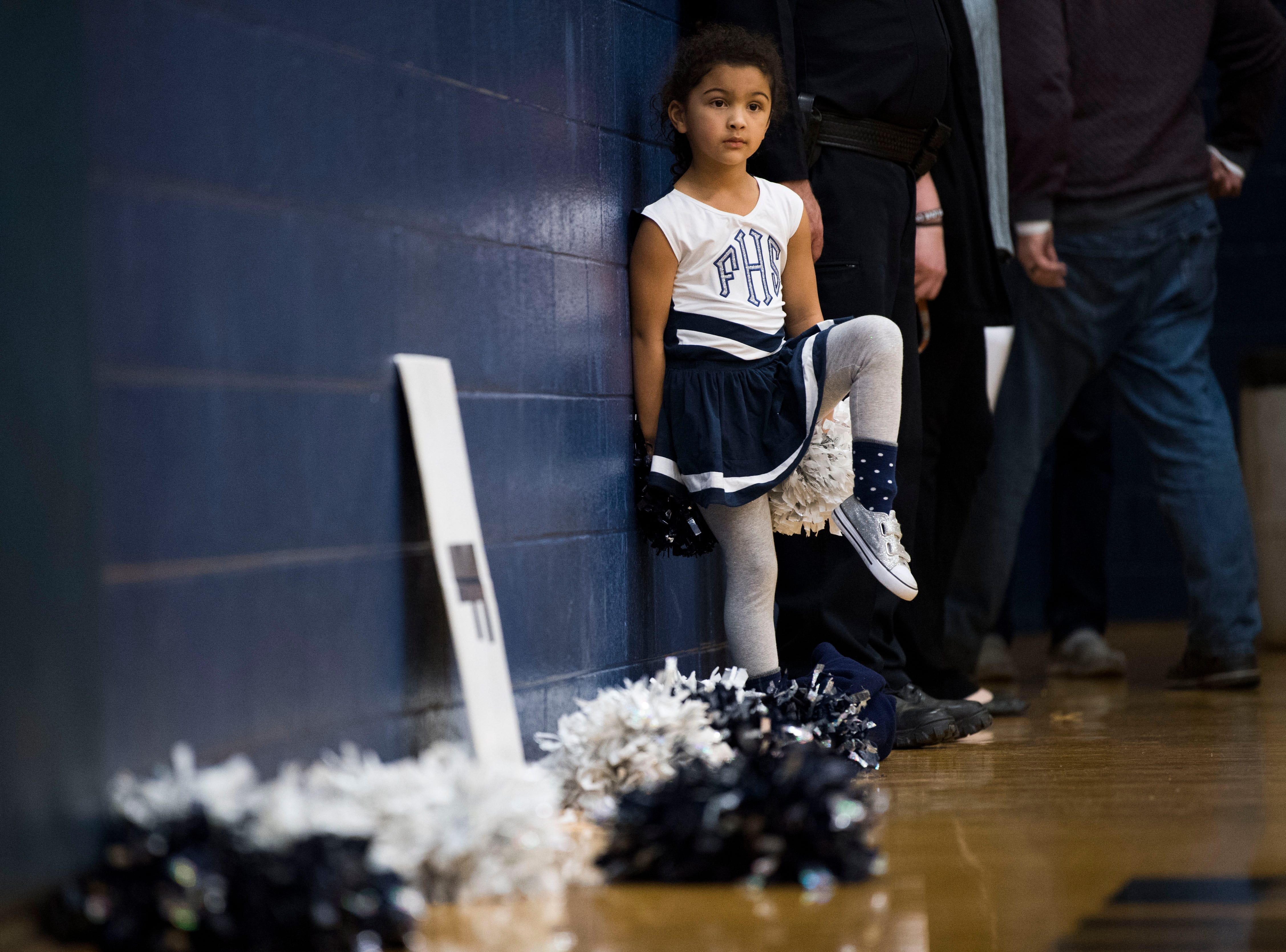 Baylor Higgins, 5, daughter of Farragut head coach Jon Higgins, watches the game during a high school basketball game between Maryville and Farragut at Farragut, Friday, Jan. 11, 2019.