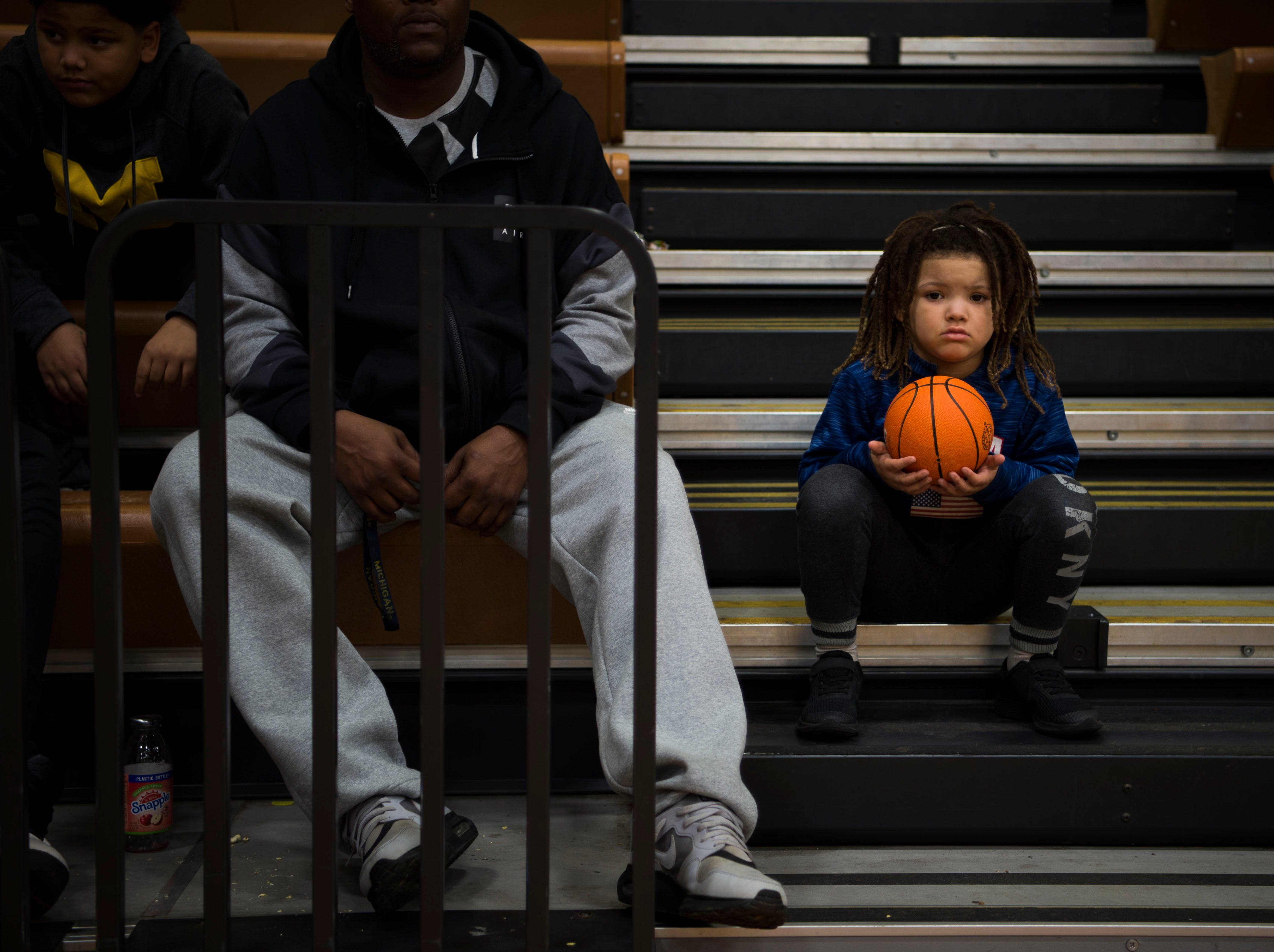 Young Maryville fan Trey Dorsey, 5, watches the game from the bleachers during a high school basketball game between Maryville and Farragut at Farragut, Friday, Jan. 11, 2019.