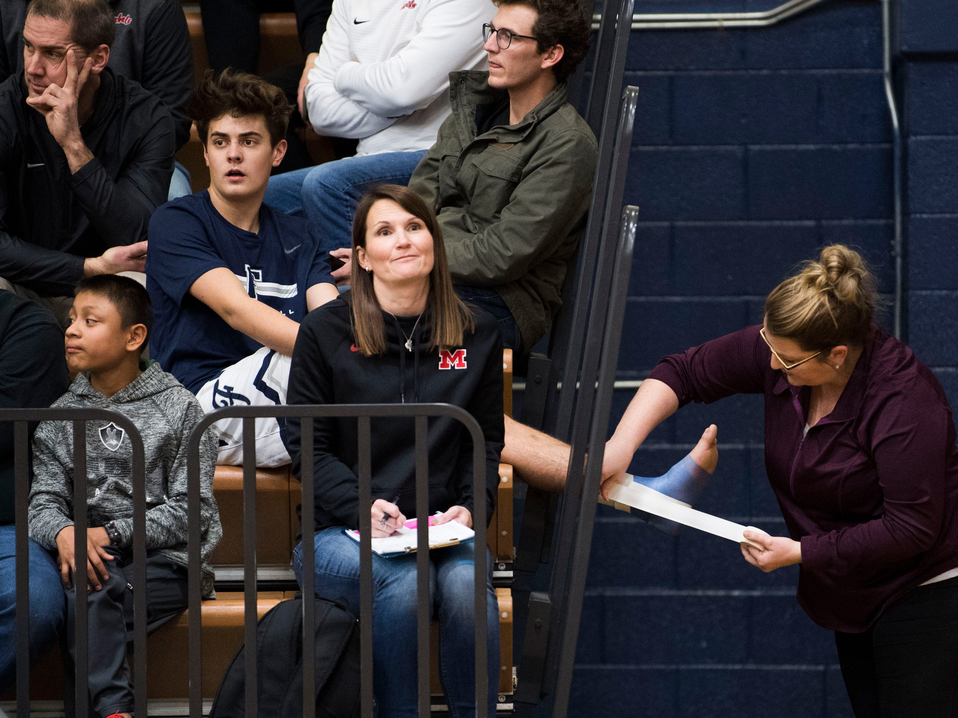 A Farragut boys player has his foot wrapped in the stands during a high school basketball game between Maryville and Farragut at Farragut, Friday, Jan. 11, 2019.