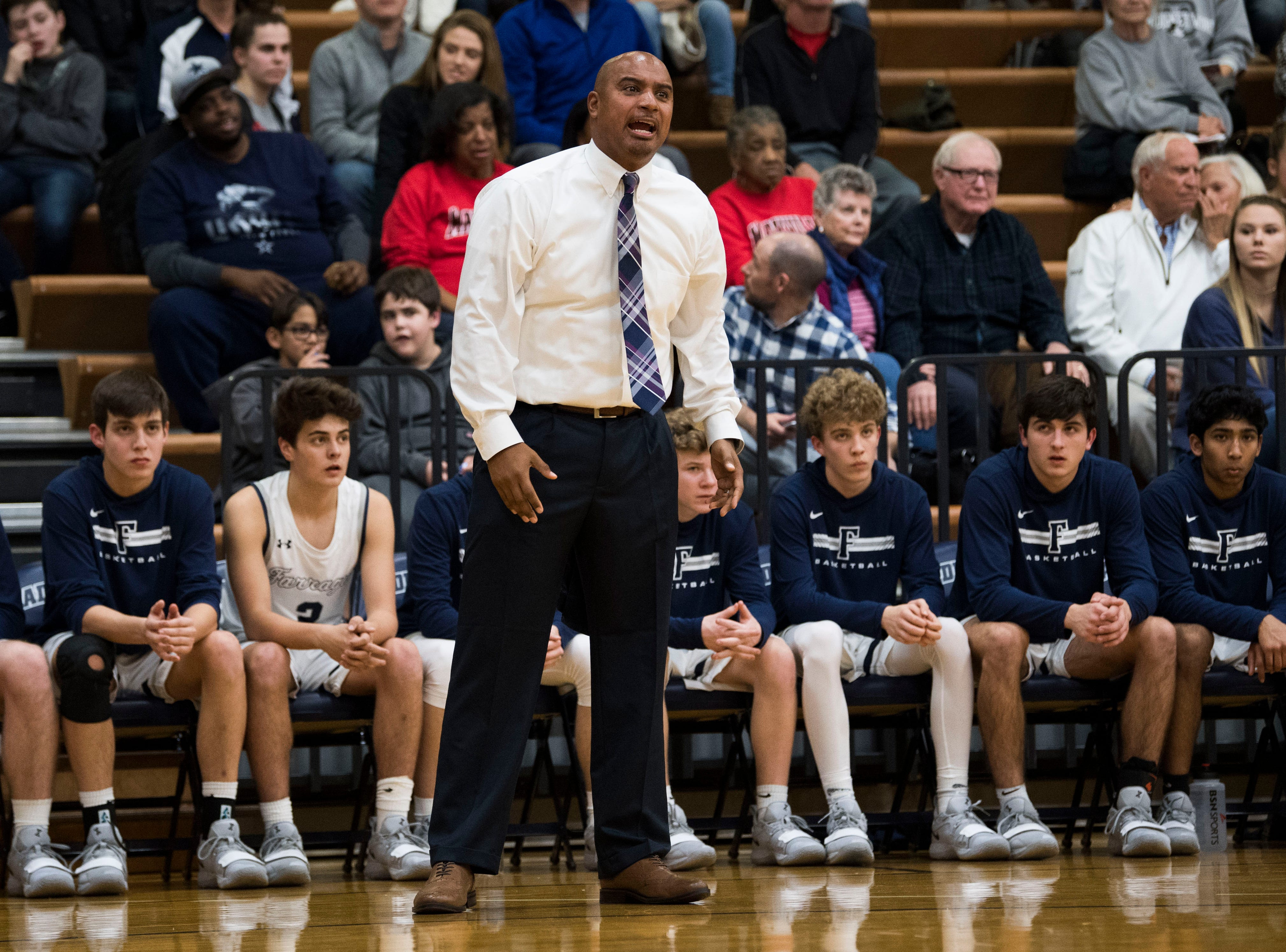 Farragut head coach Jon Higgins yells from the bench during a high school basketball game between Maryville and Farragut at Farragut, Friday, Jan. 11, 2019.