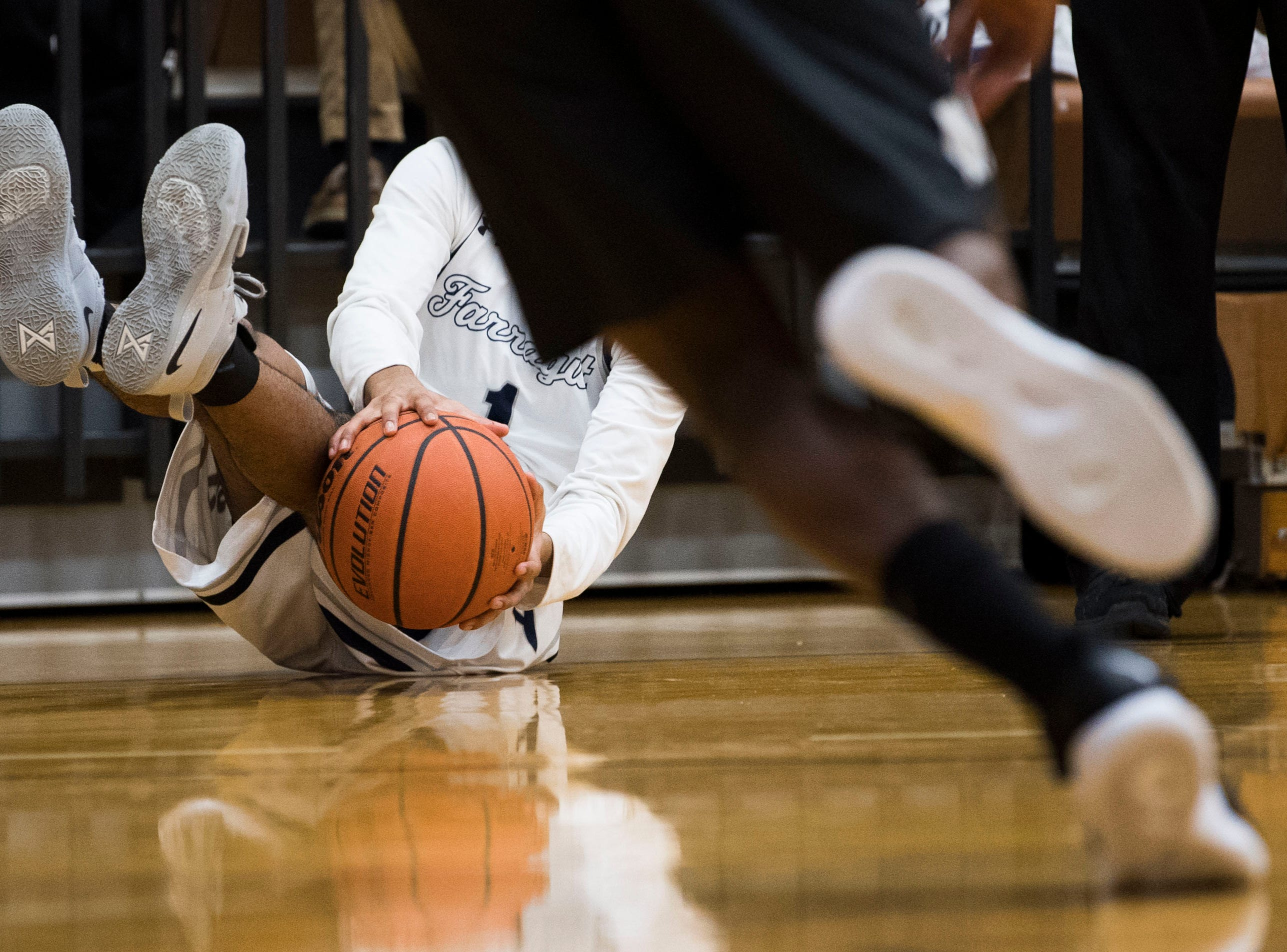 Farragut's Saish Mallory (1) slides on the ground with the ball during a high school basketball game between Maryville and Farragut at Farragut, Friday, Jan. 11, 2019.
