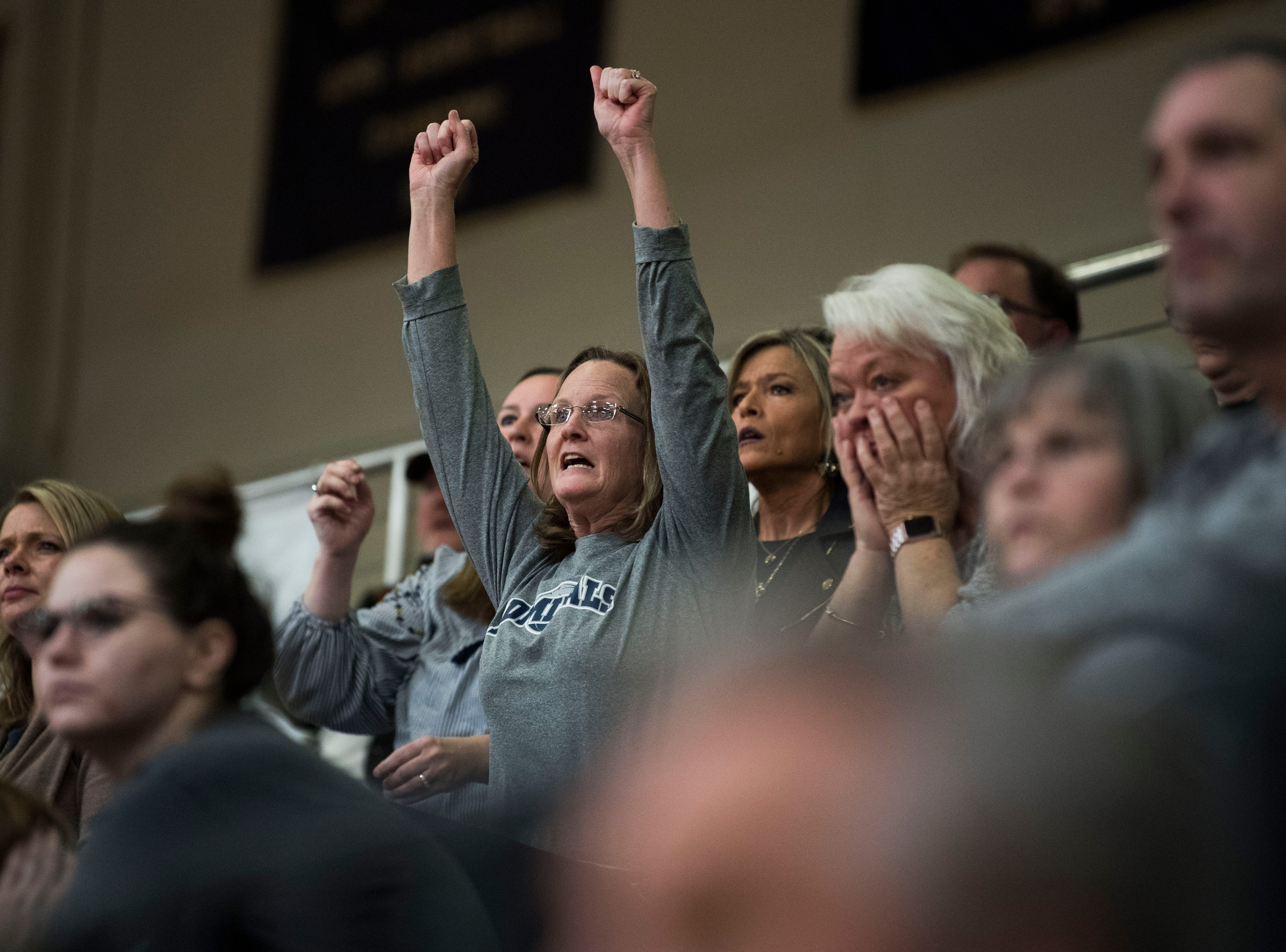 A Farragut fan celebrates during a high school basketball game between Maryville and Farragut at Farragut, Friday, Jan. 11, 2019.