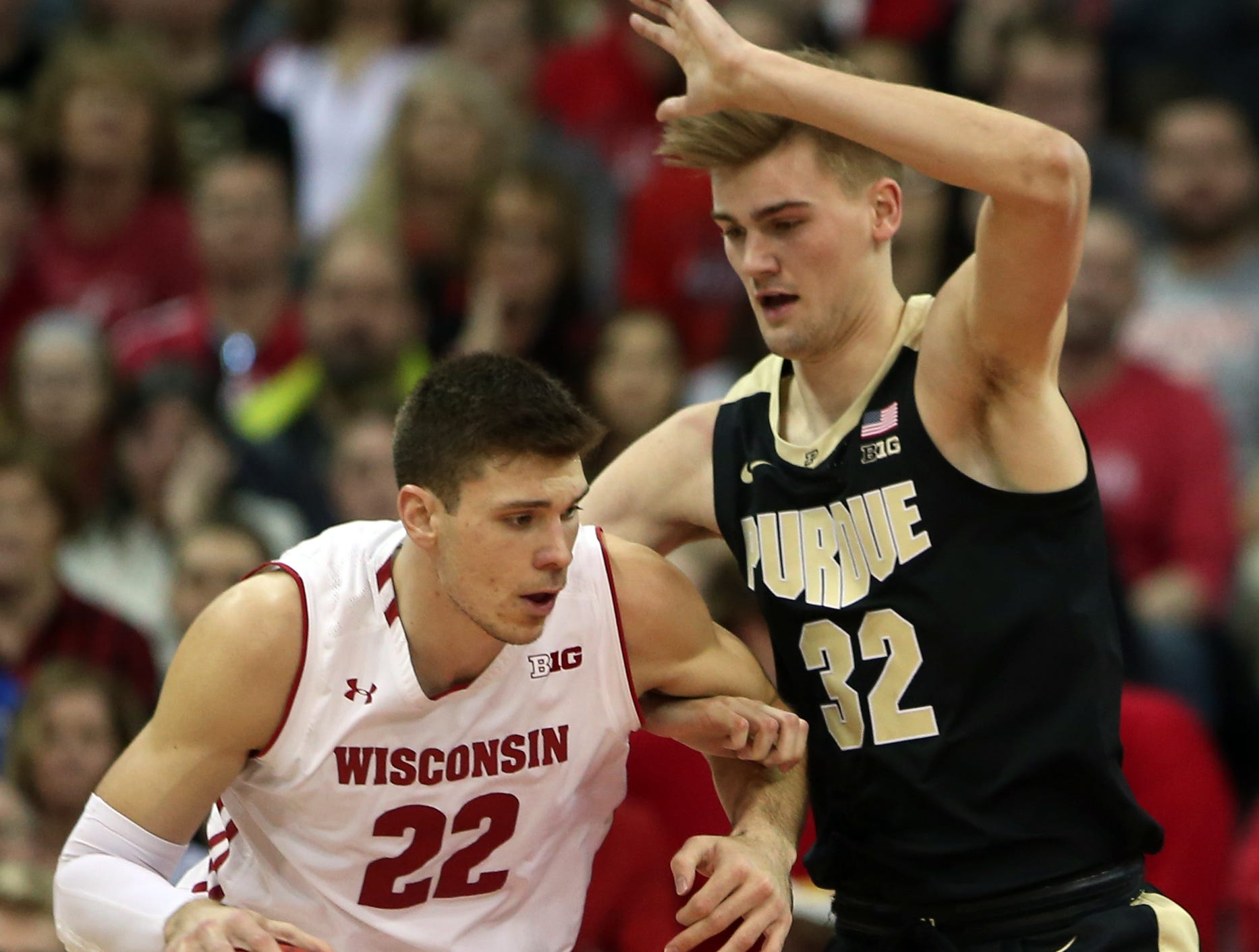 Jan 11, 2019; Madison, WI, USA; Wisconsin Badgers forward Ethan Happ (22) works the ball against Purdue Boilermakers forward Matt Haarms (32) during the first half at the Kohl Center. Mandatory Credit: Mary Langenfeld-USA TODAY Sports