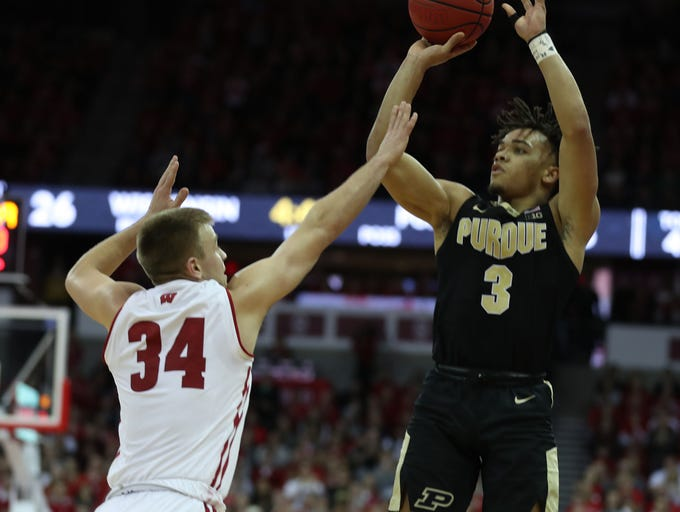 Jan 11, 2019; Madison, WI, USA; Purdue Boilermakers guard Carsen Edwards (3) attempts a basket as Wisconsin Badgers guard Brad Davison (34) defends during the first half at the Kohl Center. Mandatory Credit: Mary Langenfeld-USA TODAY Sports