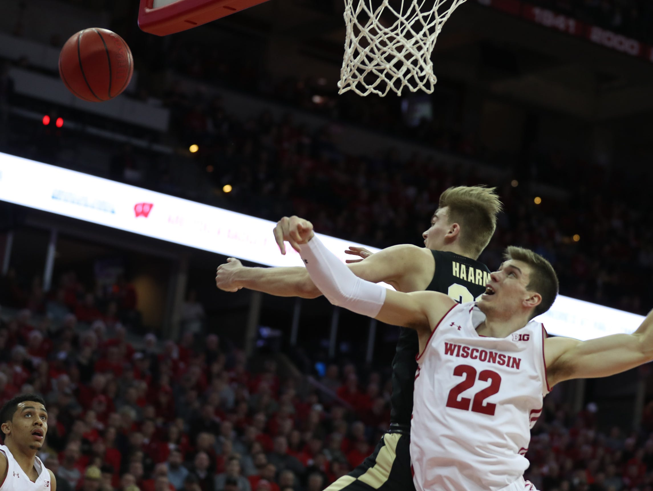 Jan 11, 2019; Madison, WI, USA; Wisconsin Badgers forward Ethan Happ (22) and Purdue Boilermakers forward Matt Haarms (32) fight for a rebound during the first half at the Kohl Center. Mandatory Credit: Mary Langenfeld-USA TODAY Sports