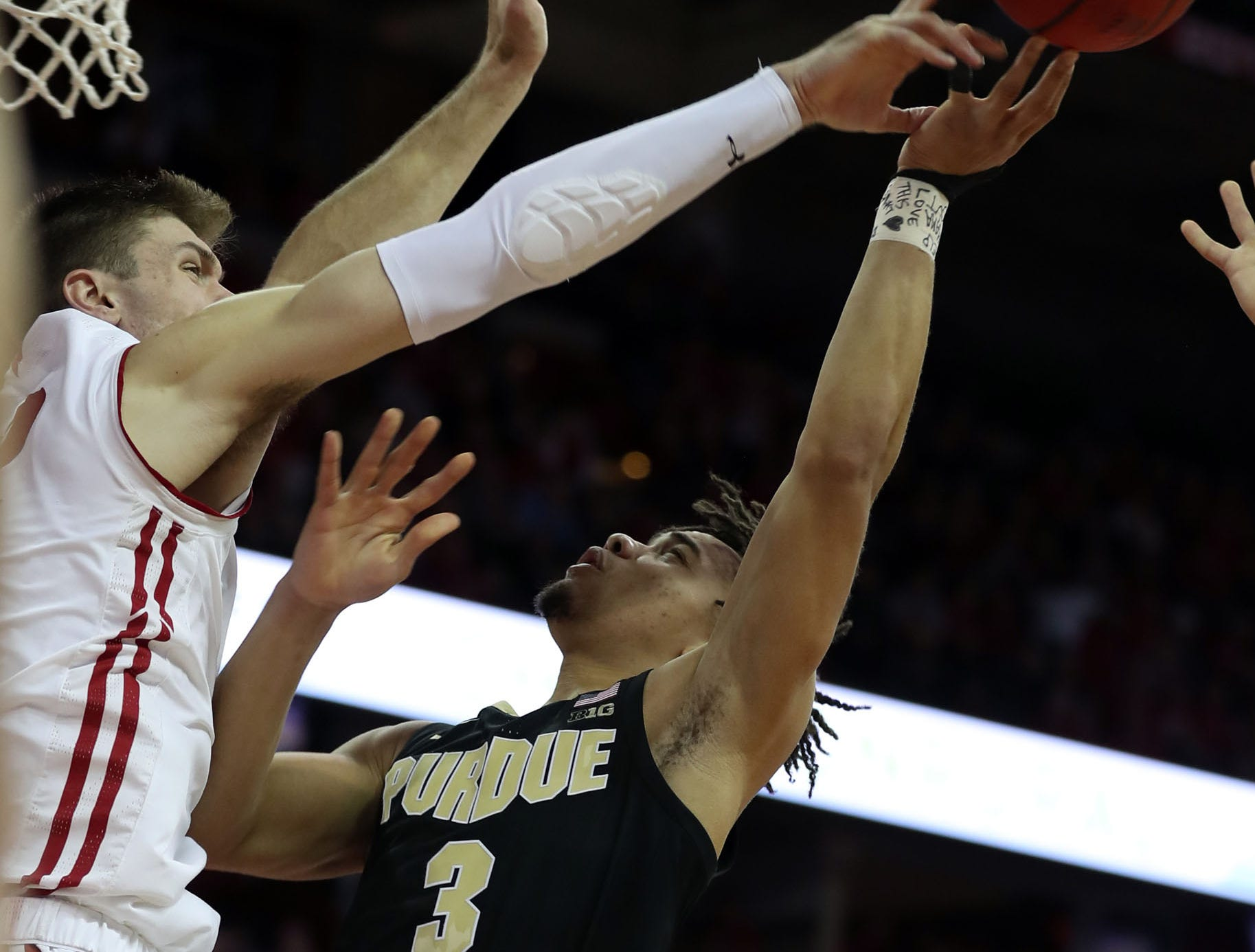 Jan 11, 2019; Madison, WI, USA; Wisconsin Badgers forward Ethan Happ (22) blocks an attempted shot by Purdue Boilermakers guard Carsen Edwards (3) during the first half at the Kohl Center. Mandatory Credit: Mary Langenfeld-USA TODAY Sports