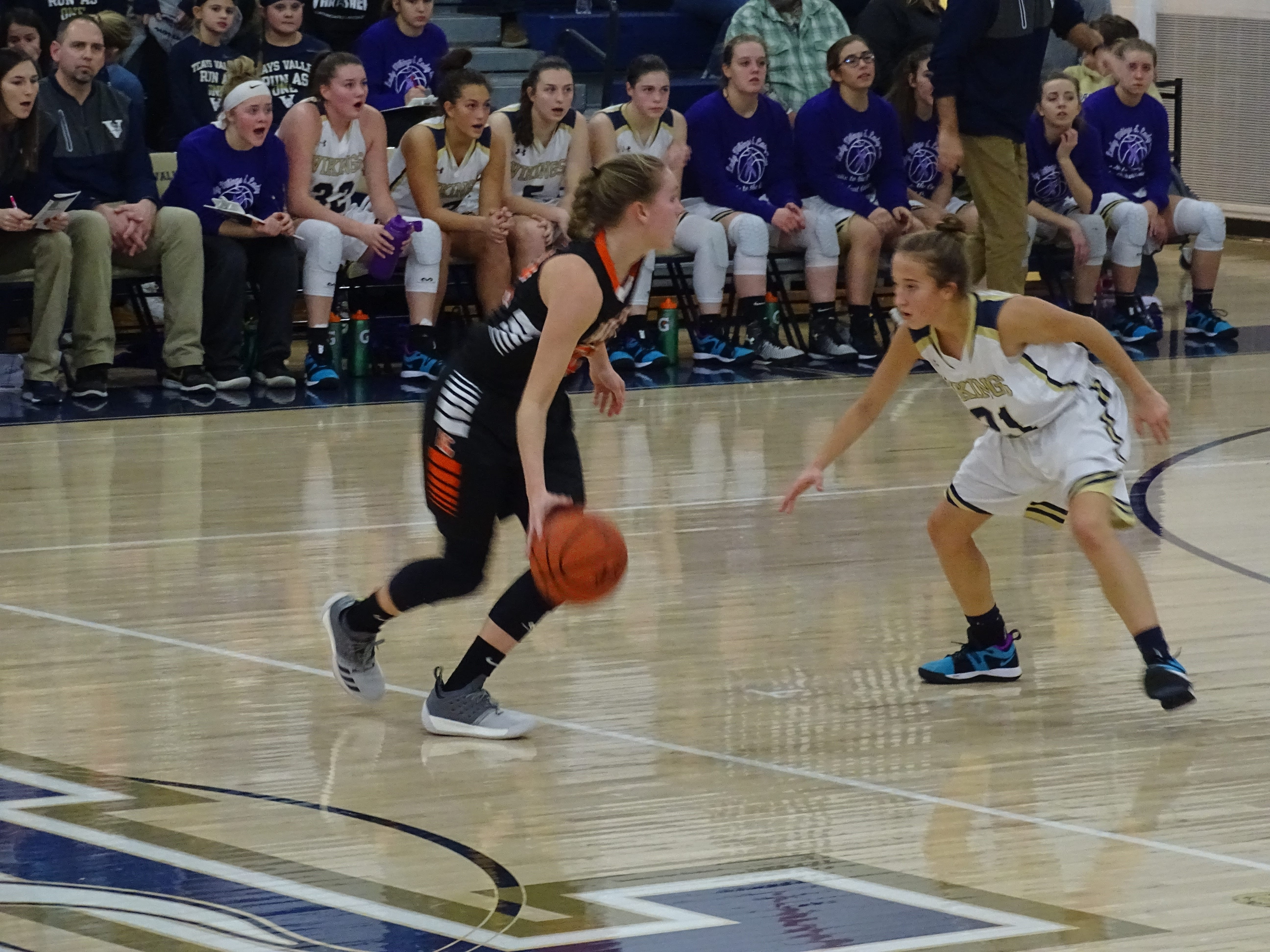 Amanda-Clearcreek senior guard gets set to make a move against a Teays Valley defender during the Aces' 55-41 loss Friday night.
