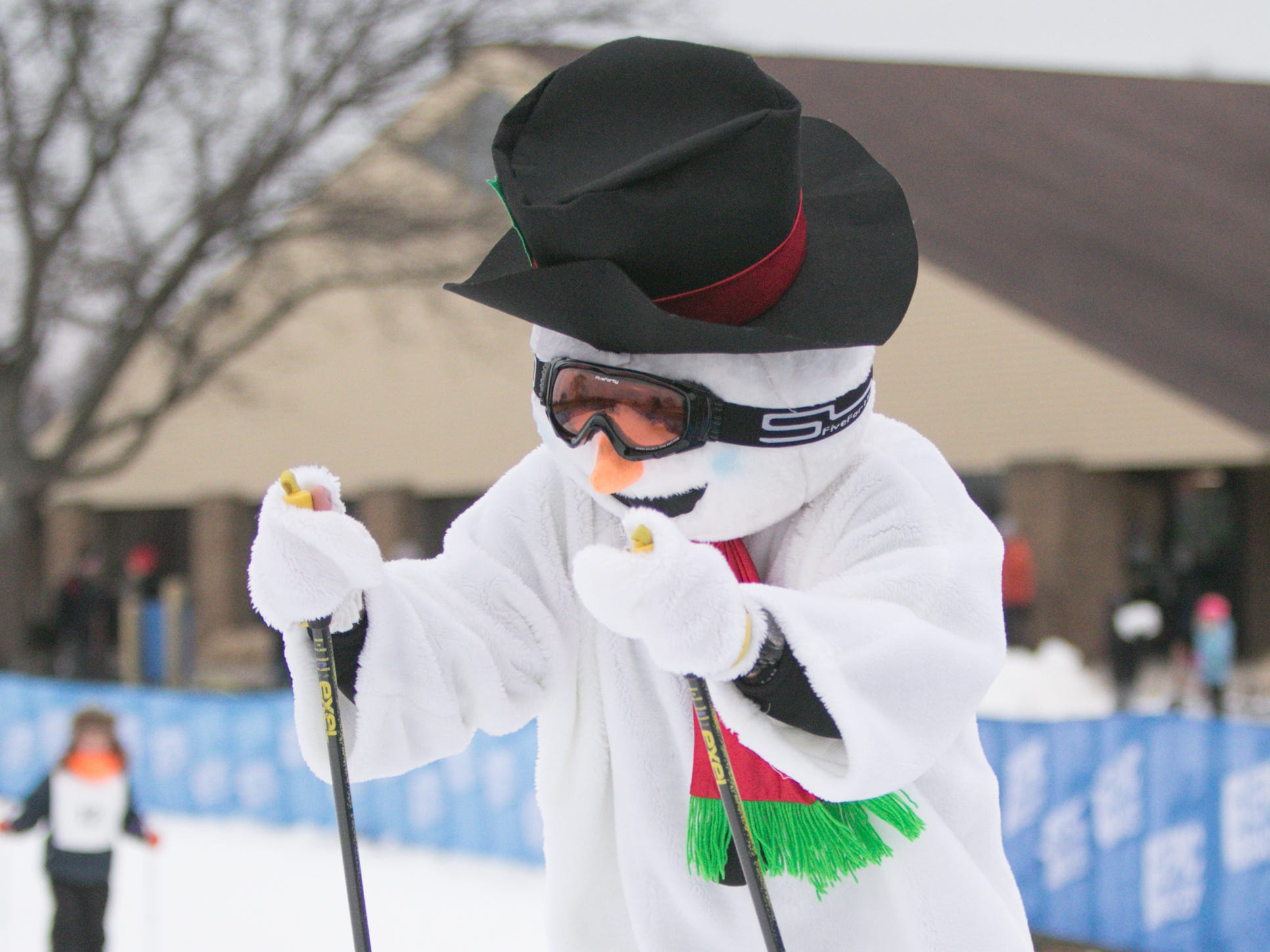 Frosty the skiing snowman accompanies kids age five to 11 in the Frosty Ski Fest kids' race Saturday, Jan. 12, 2019.