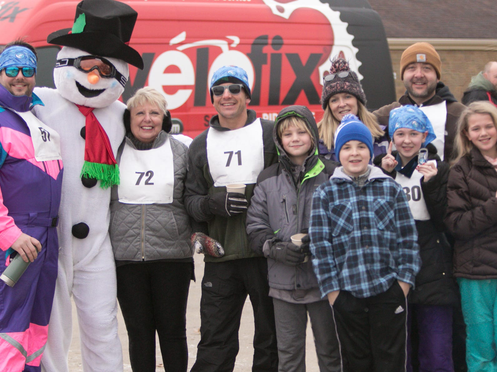 The Ferrera and Jones families pose with Frosty the skiing snowman between events at the Frosty Freestyle cross-country ski event Saturday, Jan. 12, 2019.