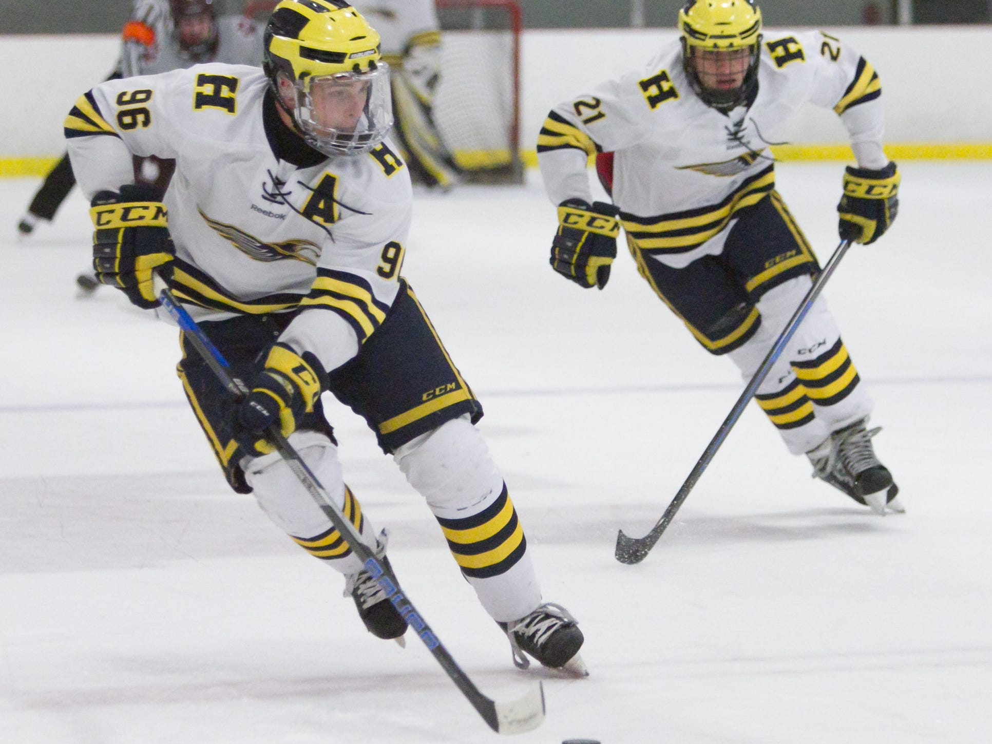 Hartland's Owen Pietila (96) and Trent Krause (21) rush up the ice in a 2-1 victory over Detroit U of D Jesuit on Friday, Jan. 11, 2019 at Hartland Sports Center.