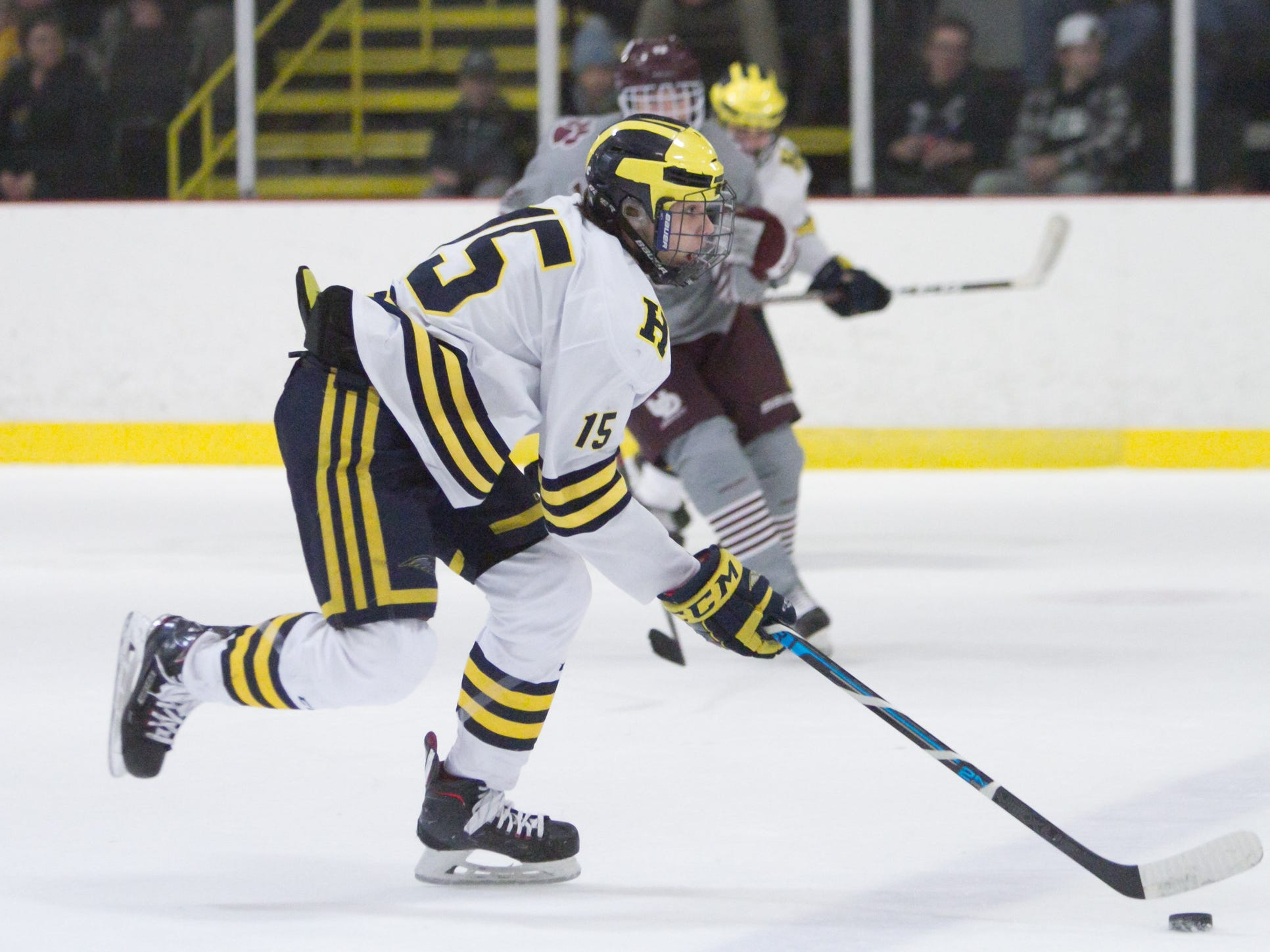 John Druskinis of Hartland carries the puck in a 2-1 victory over Detroit U of D Jesuit on Friday, Jan. 11, 2019 at Hartland Sports Center.