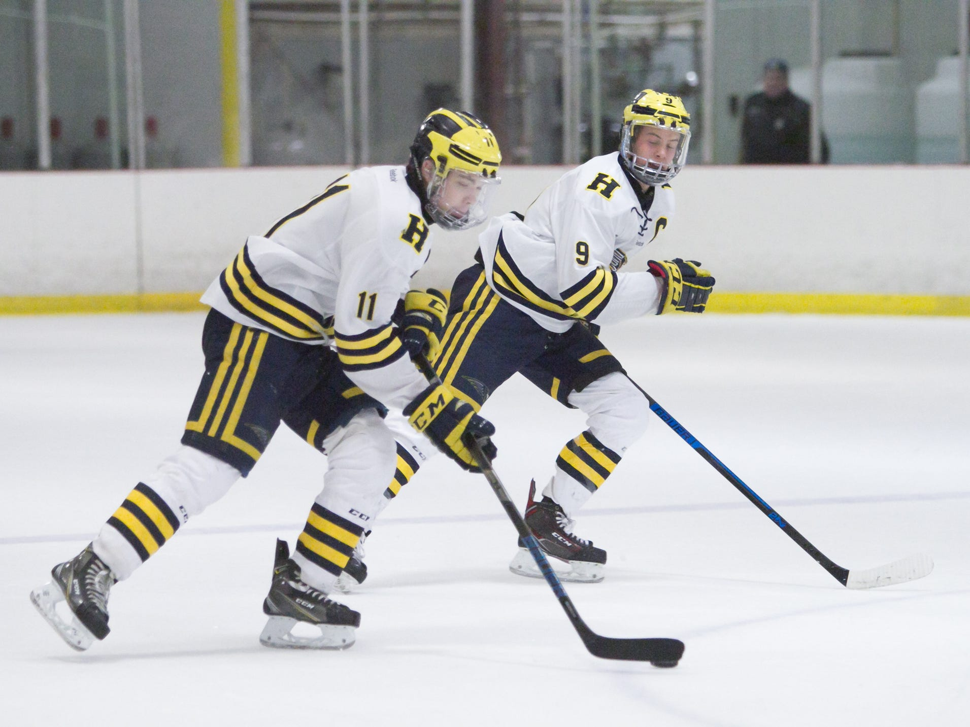Gabe Anderson (11) leads a Hartland rush with teammate Joey Larson in a 2-1 victory over Detroit U of D Jesuit on Friday, Jan. 11, 2019 on Hartland Sports Center.