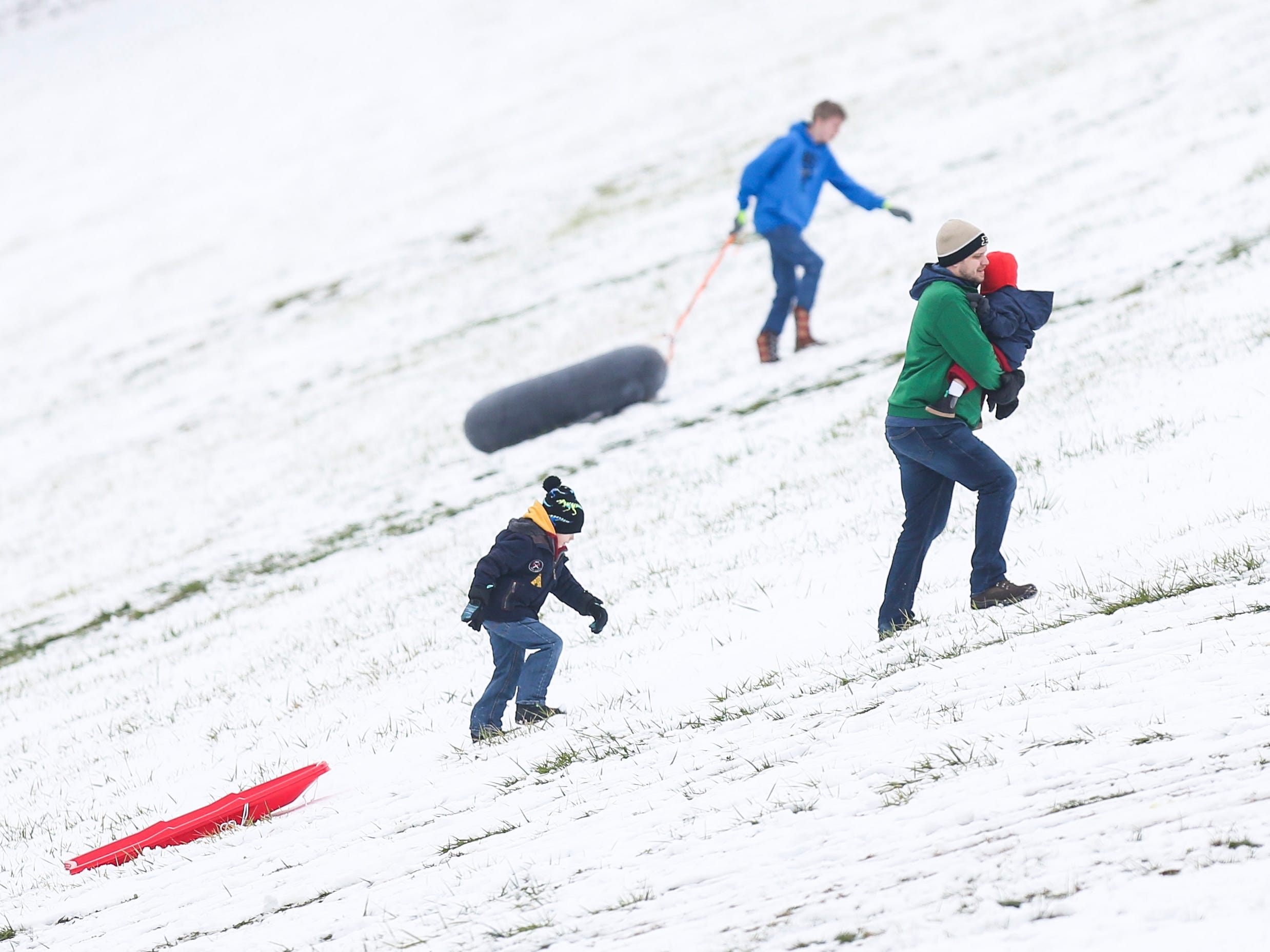 Funseekers used the flood wall in New Albany for sledding Saturday afternoon after the season's first snowfall. New Albany has around 2.8 miles of the earth levee that was installed after the 1937 flood. January 12, 2019
