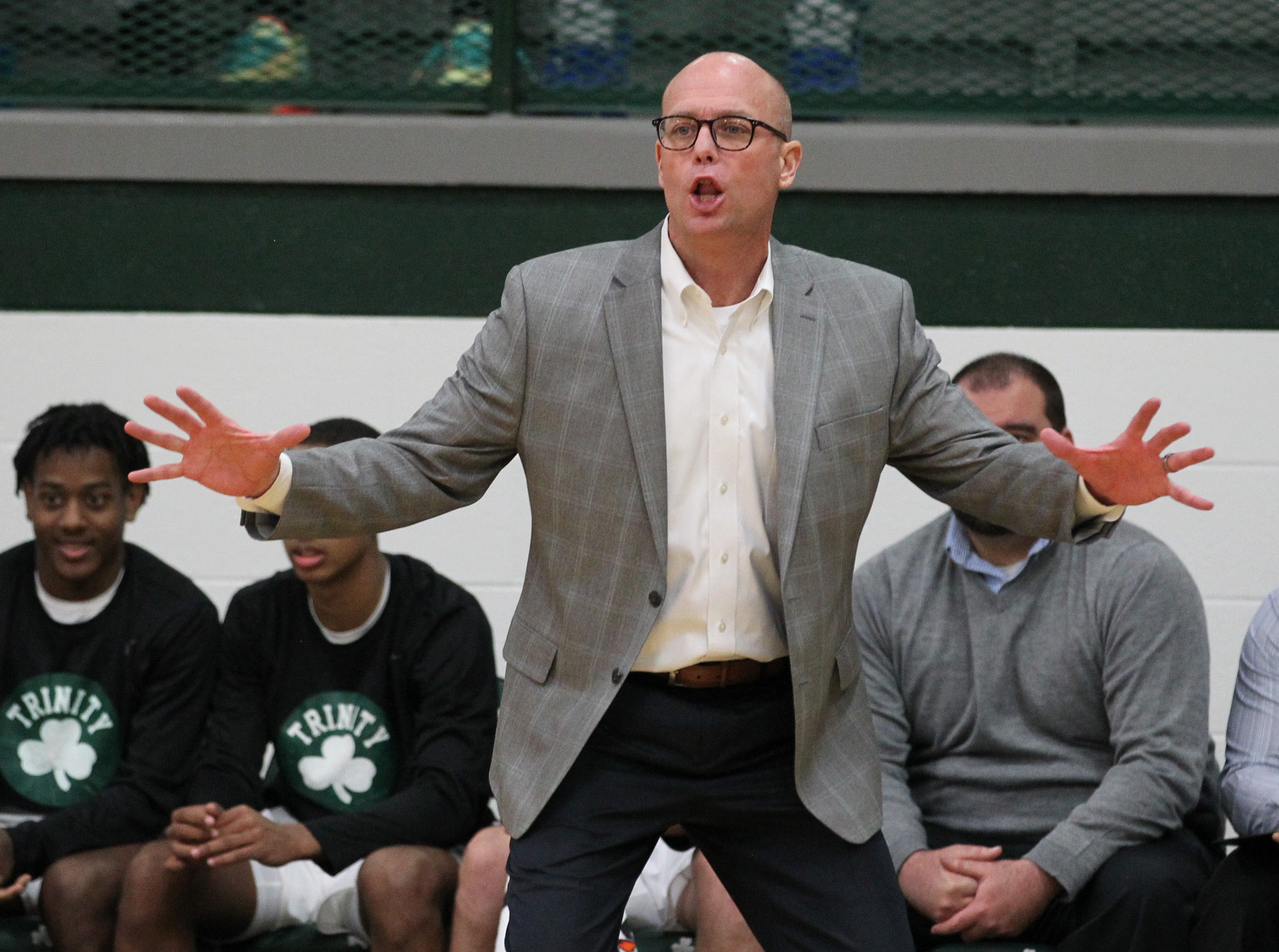Trinity High School head coach Mike Szabo reacts to his teams plan against Waggener High School during the first half of play at Trinity High School on Jan. 11,  2019.