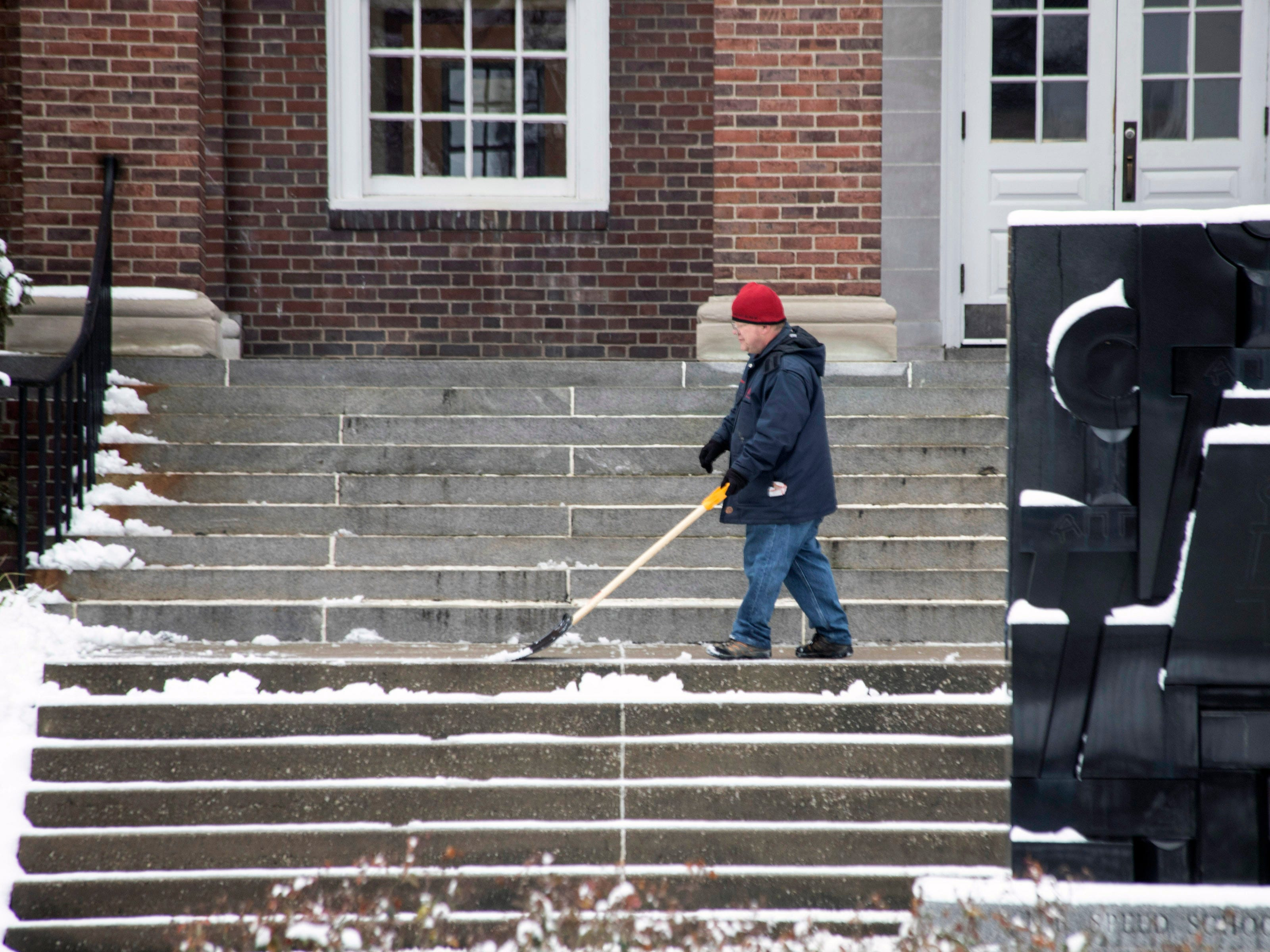 Workers cleared stairwells and sidewalks on the U of L campus after Louisville received its first snowfall of 2019 on Saturday. 1/12/19