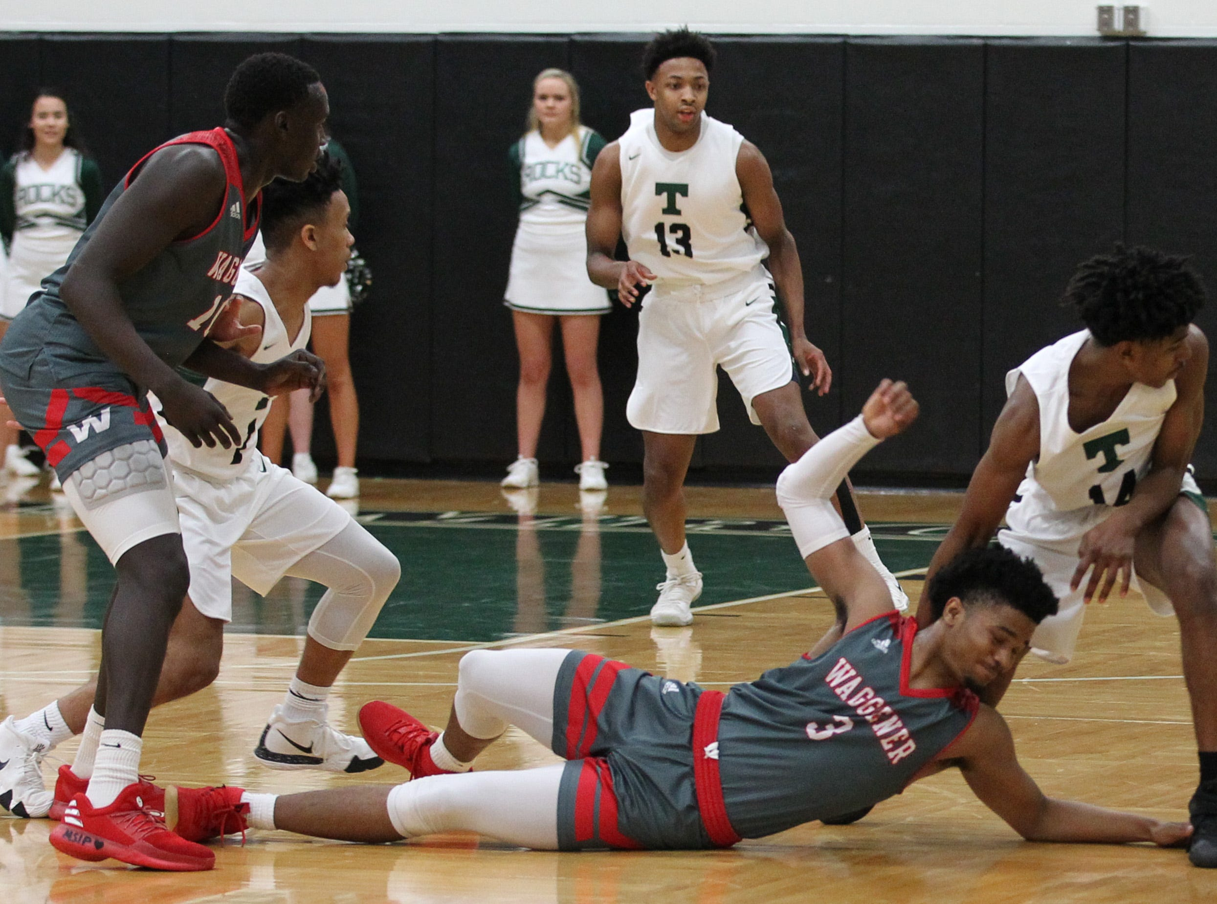 Trinity High School's Kamari Kenemore (10) fights for the loose ball with Waggener High School's Dallas Rufus (3) during the first half of play at Trinity High School in Louisville, Kentucky,       Jan. 11,  2019.