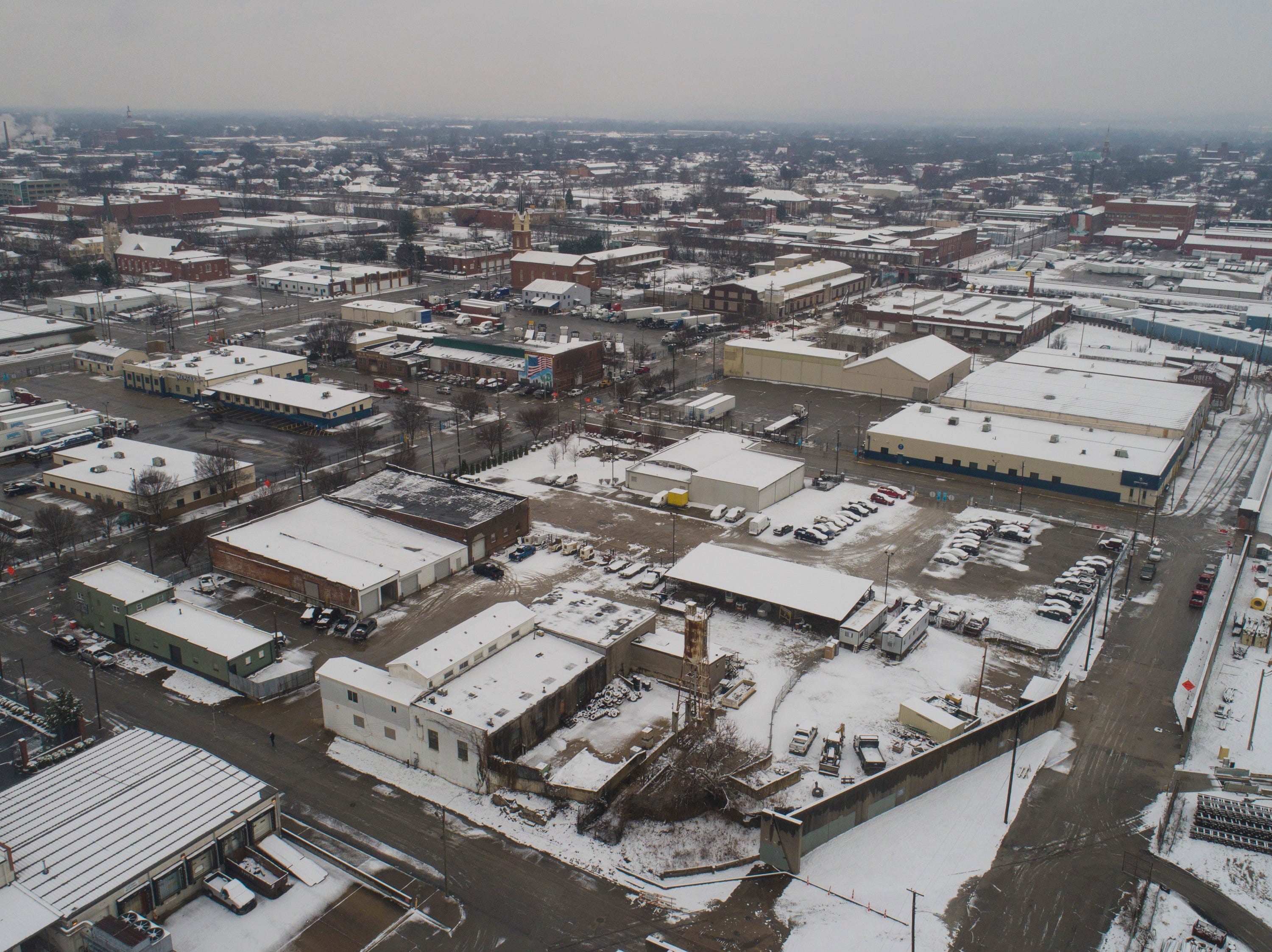 An overview of downtown Louisville just west of Ninth Street Saturday morning after the few inches of snow fell through the night. Jan. 12, 2019