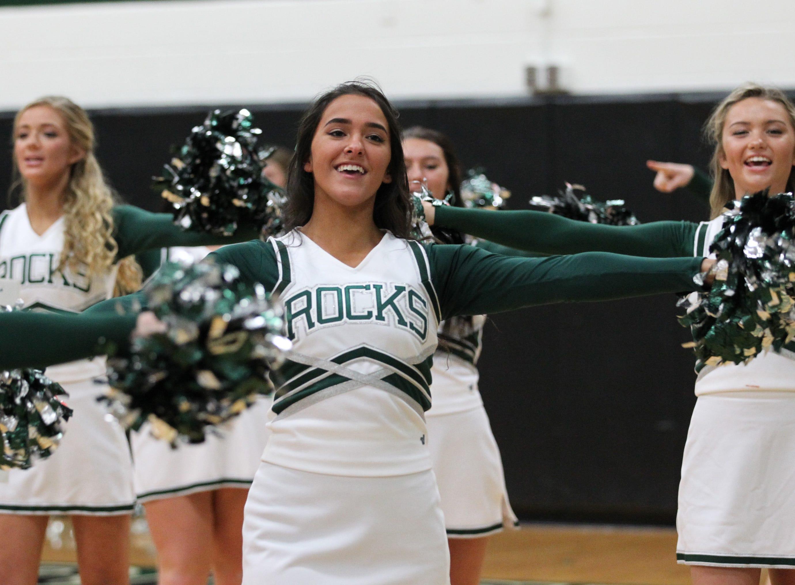 Trinity High School cheerleaders cheer for their team against Waggener High School in Louisville on Jan. 11, 2019.