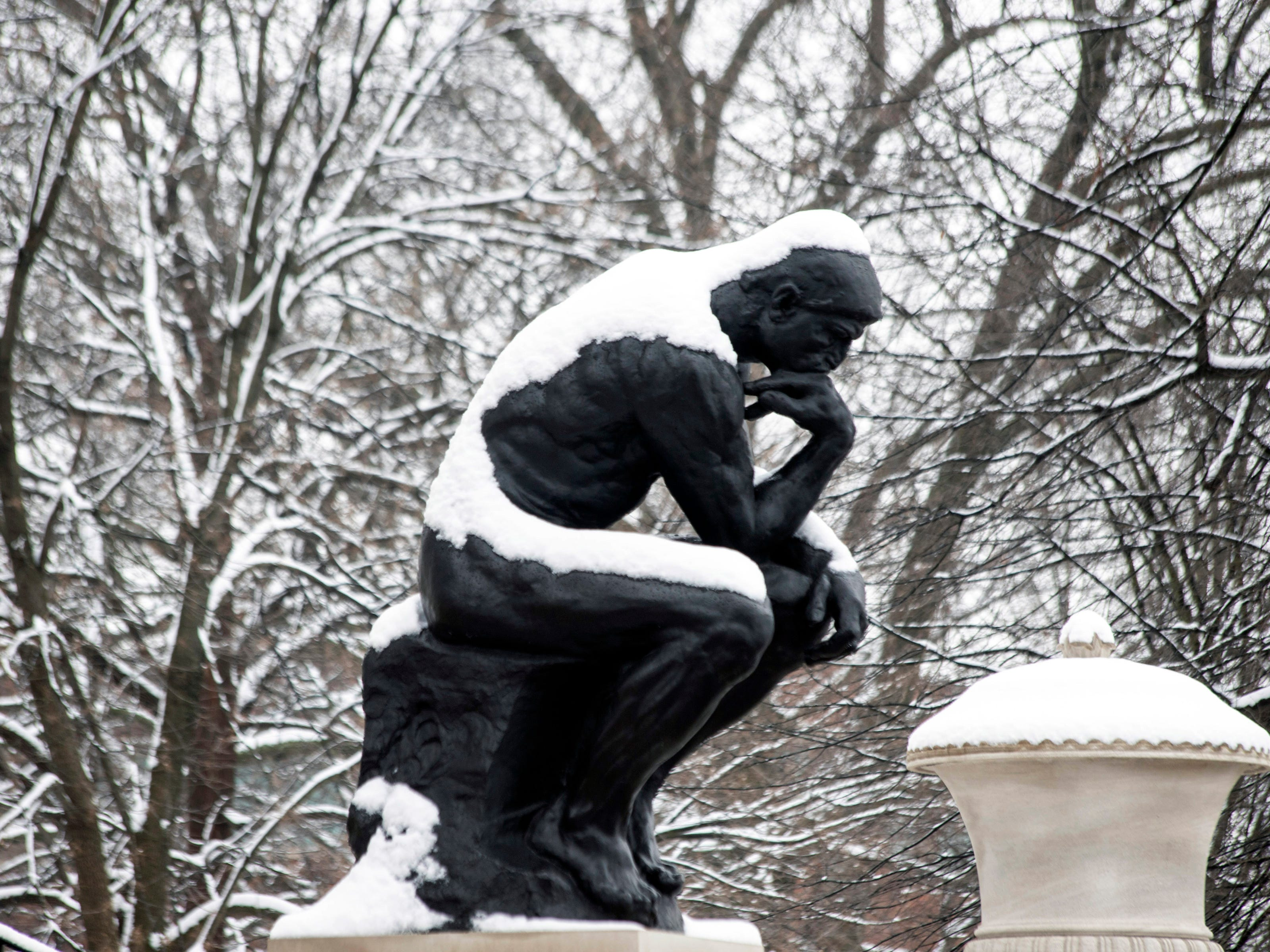 The University of Louisville campus and the Thinker statue had a blanket of snow on Saturday morning. 1/12/19