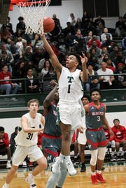 Trinity's Kolton Rice gets up a shot in a game earlier this year against Waggener.