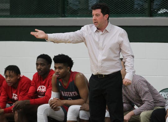 Waggener High School head coach Bryan O'Neill reacts to his team's play against Trinity High School on Jan. 11,  2019.