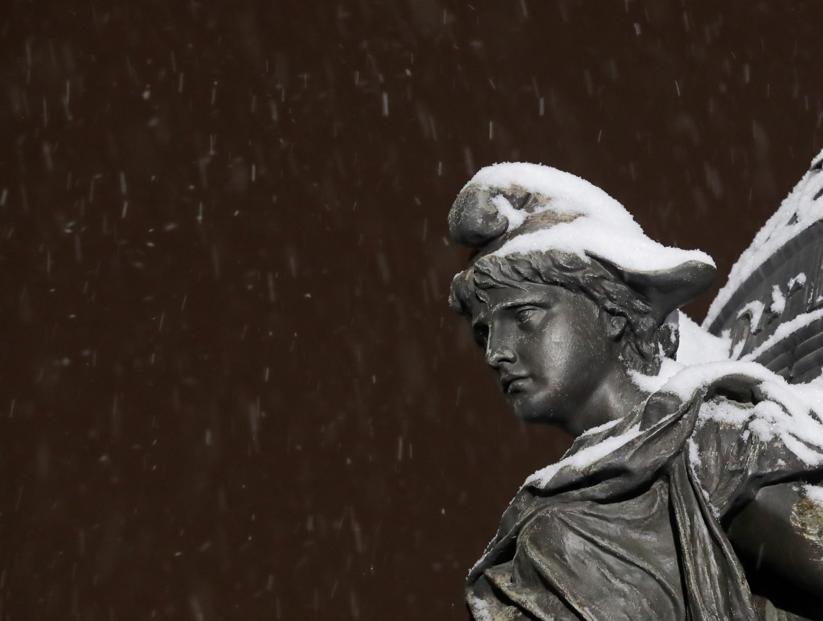 Snow falls on downtown Louisville Friday night.