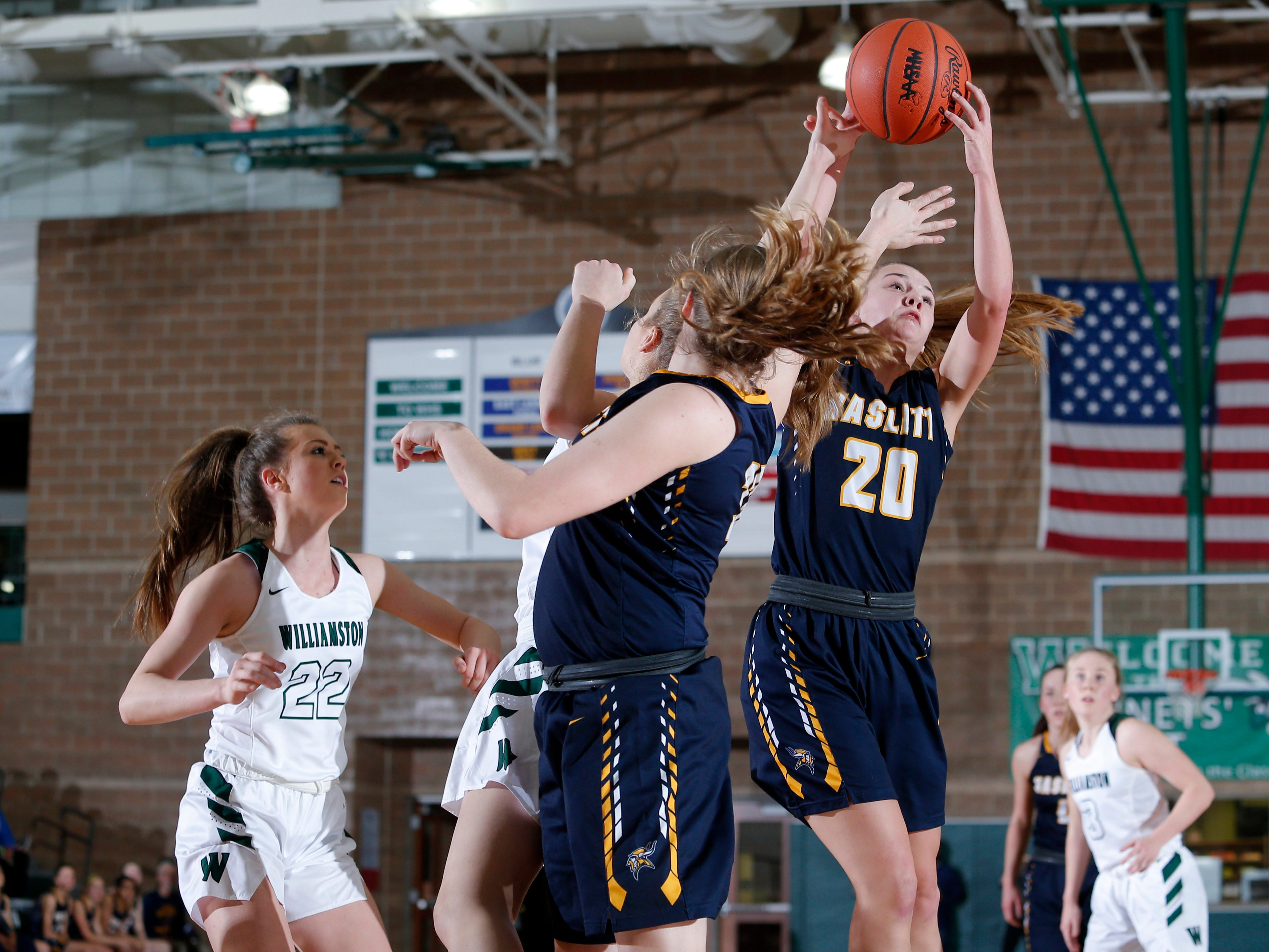 Haslett's Skyla Nosek, right, grabs a rebound against Williamston, Friday, Jan. 11, 2019, in Williamston, Mich.