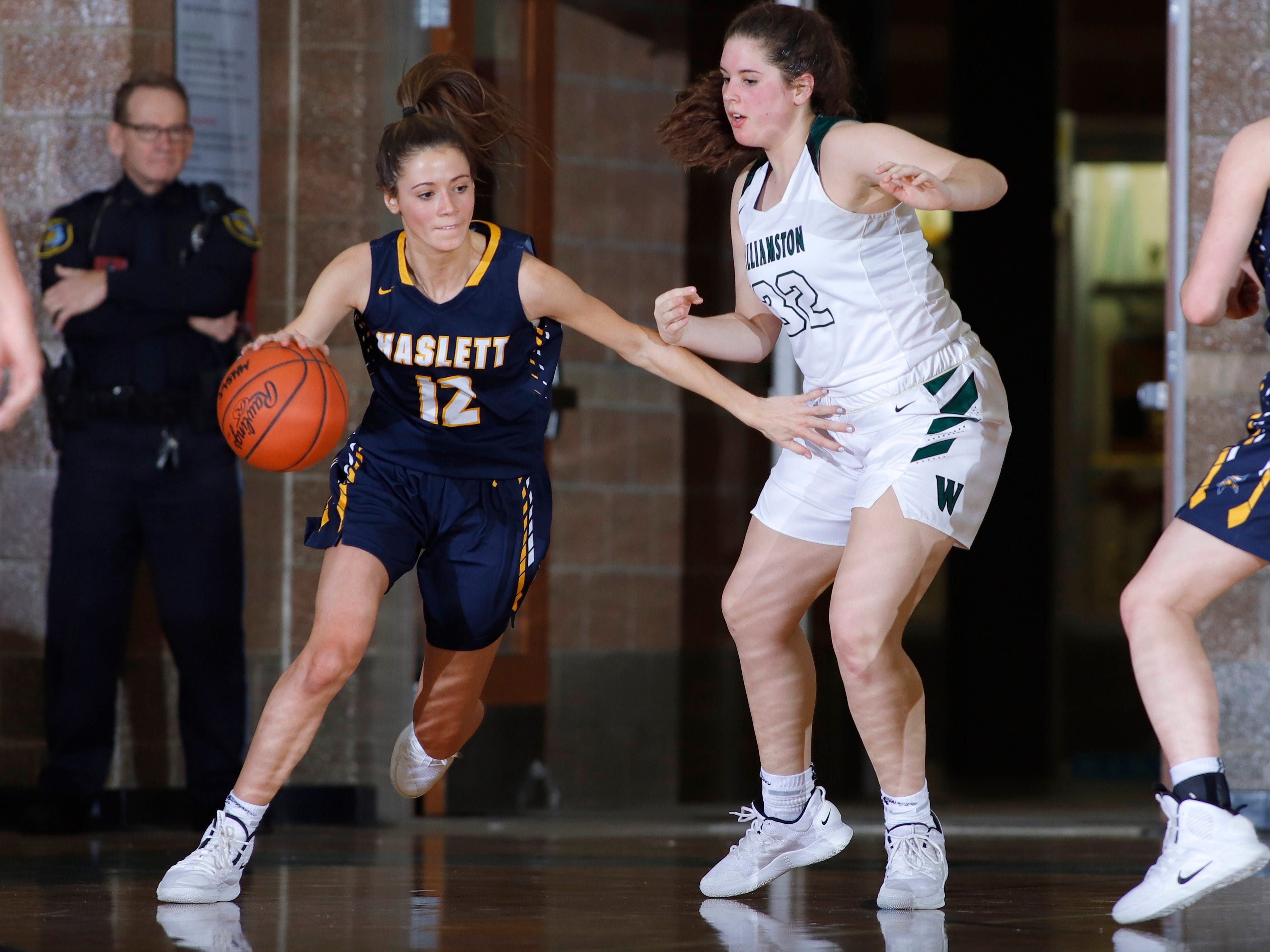 Haslett's Brenna Bailey, left, drives against Williamston's Meghan Douglass, Friday, Jan. 11, 2019, in Williamston, Mich.